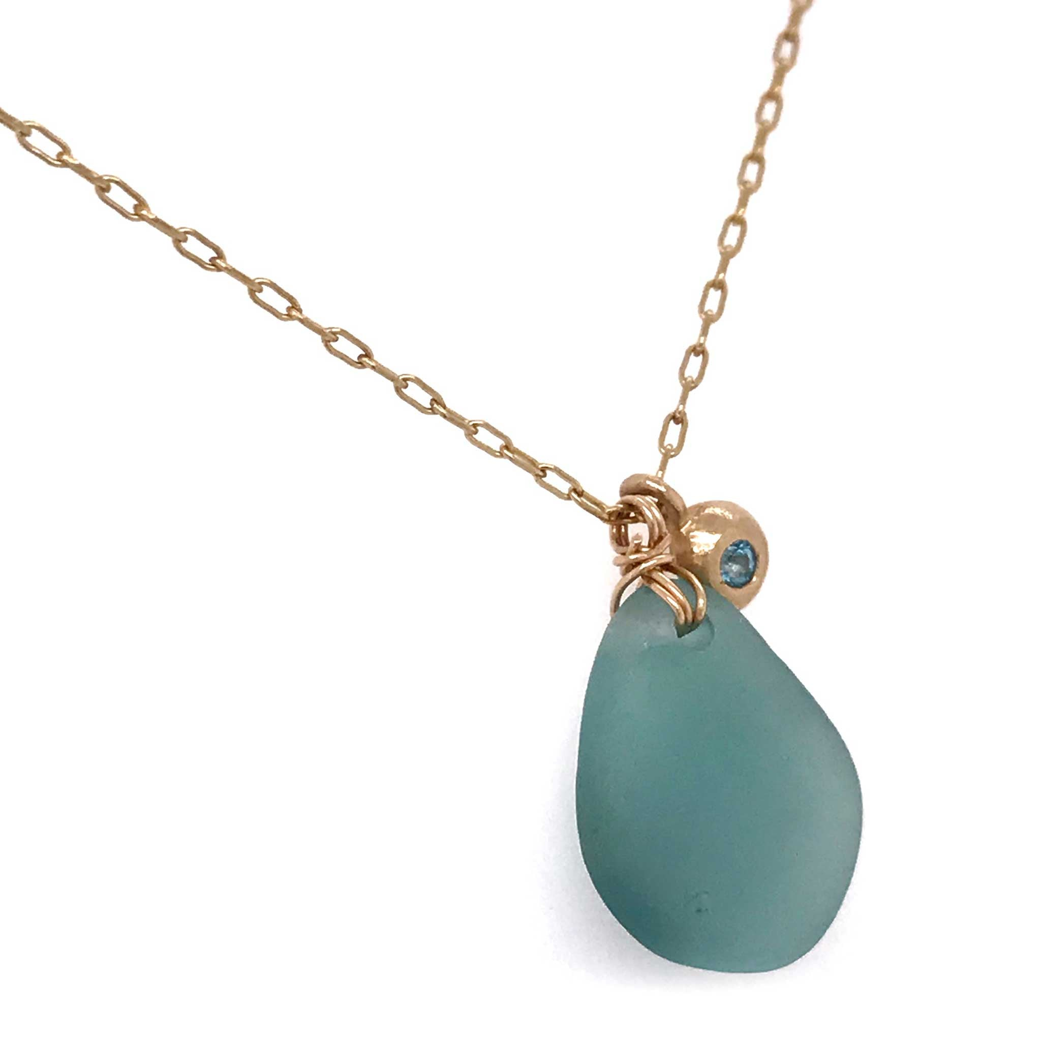 aqua seaglass necklace with gold charm and london blue topaz kriket broadhurst jewellery near me