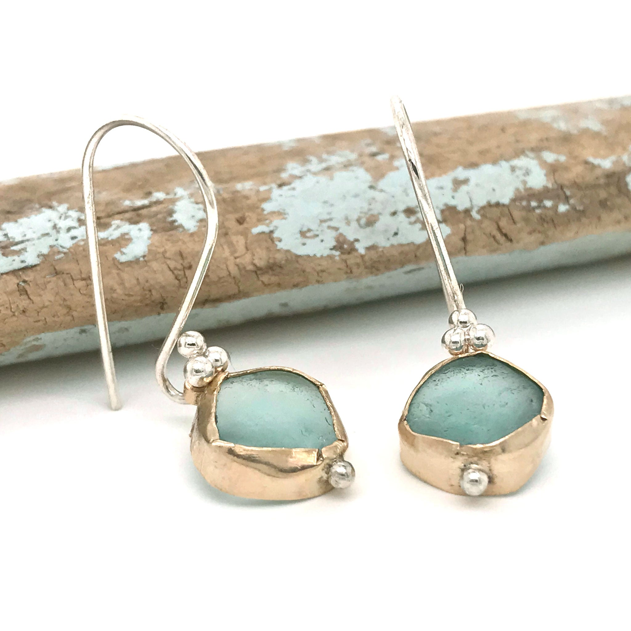aqua seaglass earrings bezel set in gold hanging on silver hooks Kriket Broadhurst jewellery