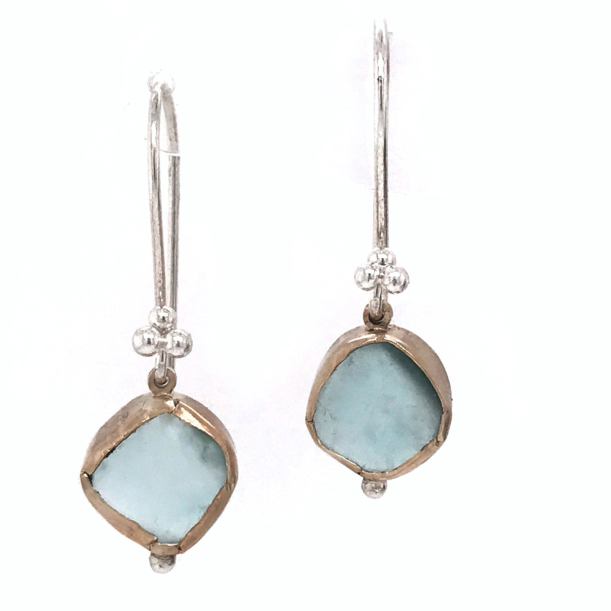 aqua beach glass earrings bezel set in 14k gold hanging on silver hooks Kriket Broadhurst seaglass jewellery
