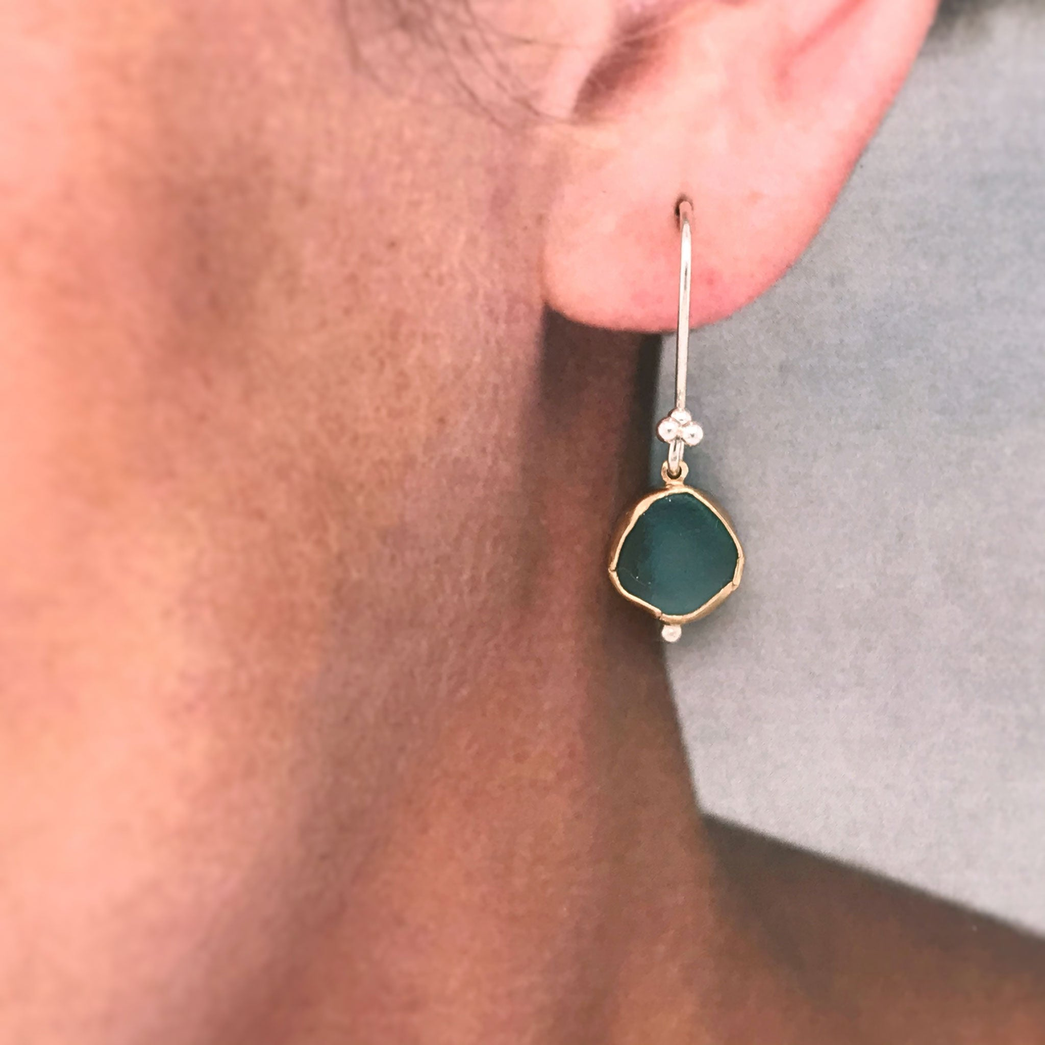 aqua seaglass earrings bezel set in 14k gold hung on silver hooks Kriket Broadhurst jewellery