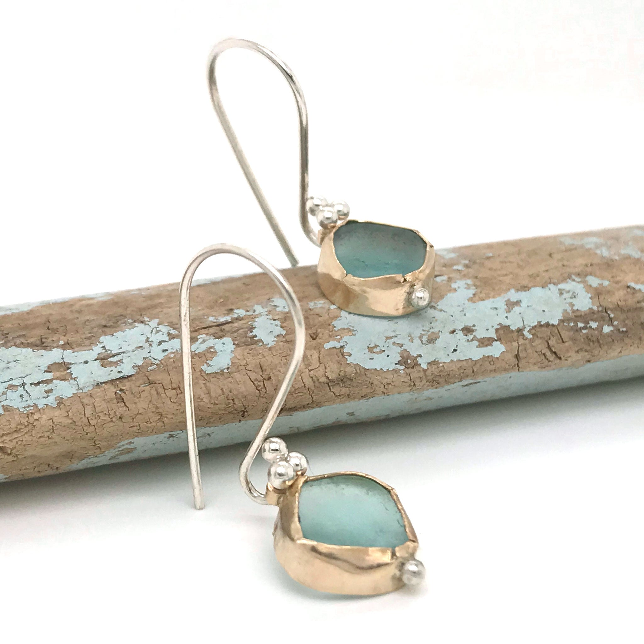 aqua seaglass bezel set in 14k gold hung on sterling silver hooks Kriket Broadhurst earrings