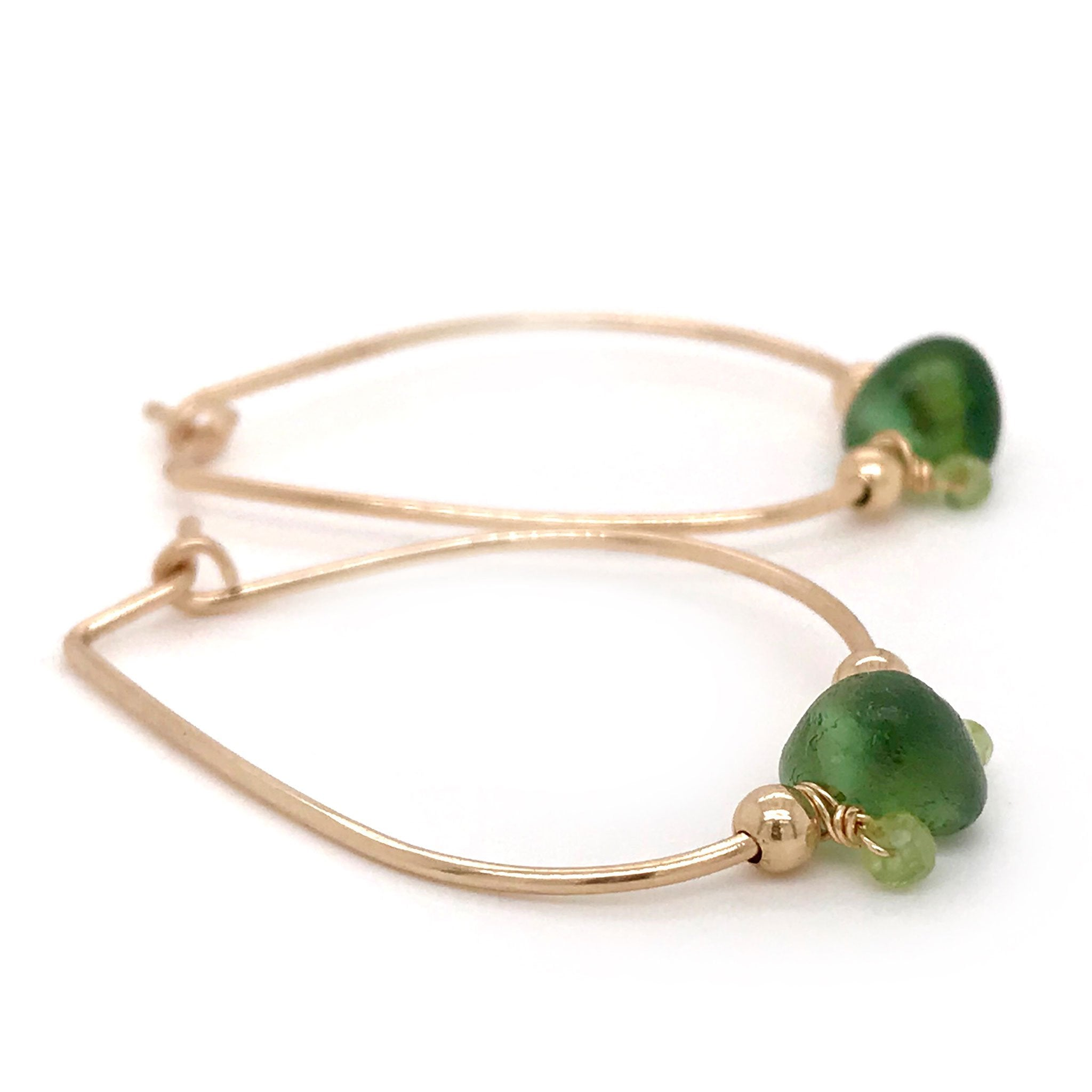 dark green seaglass earrings gold hoops with peridot stones Kriket Broadhurst jewellery