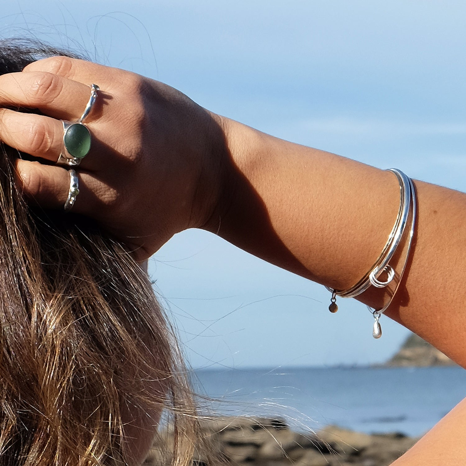 Silver stacking Bangles - kriket broadhurst jewellery on model