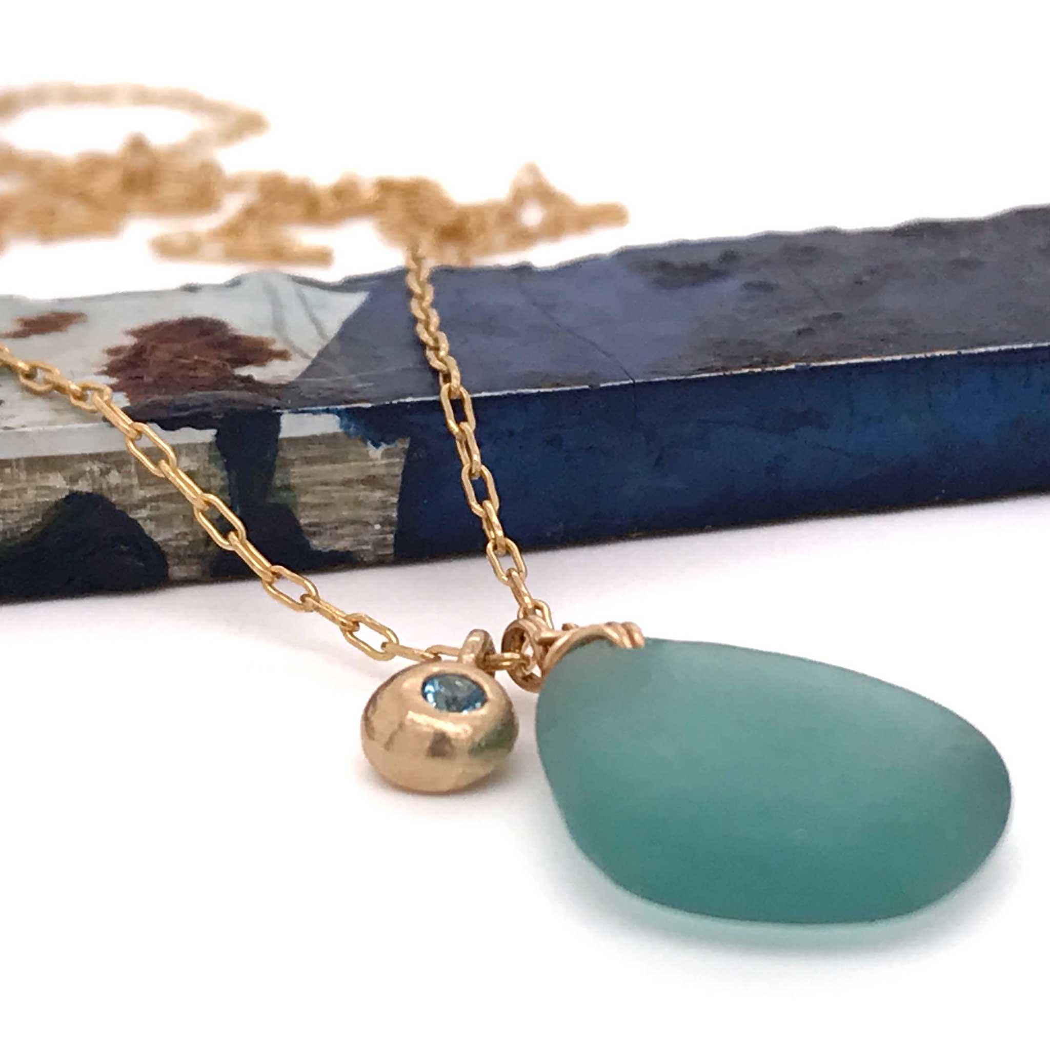 unique gift gold necklace with aqua sea glass and gold charm kriket broadhurst jewelry store near me