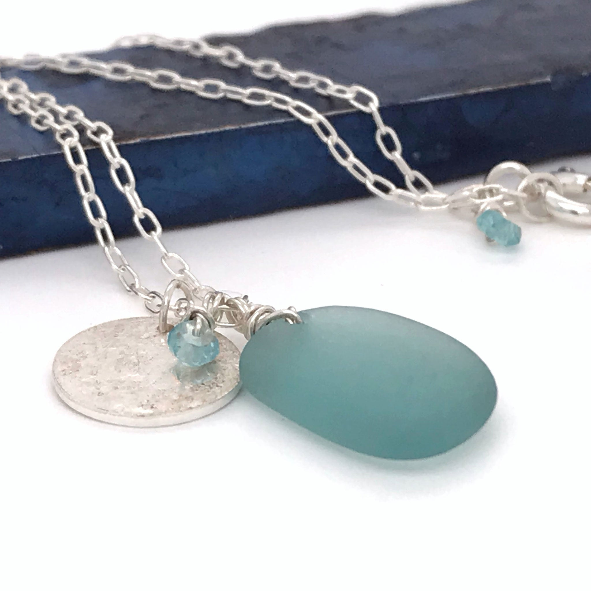 sterling silver charm necklace with Japanese aqua seaglass and disc charm kriket broadhurst jewellery