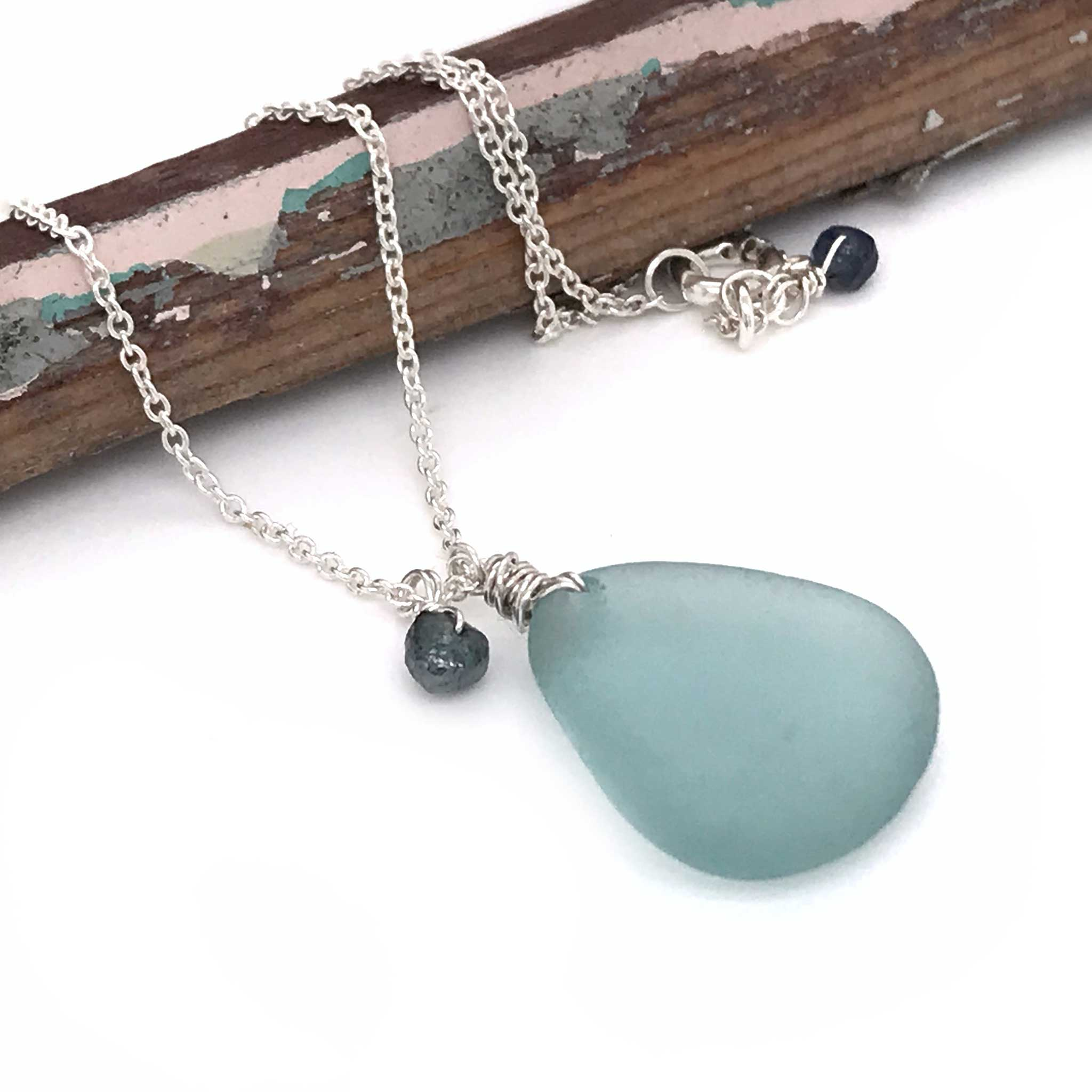 aqua blue sea glass on sterling silver chain with rough cut diamond and sapphire Kriket Broadhurst jewellery Australia
