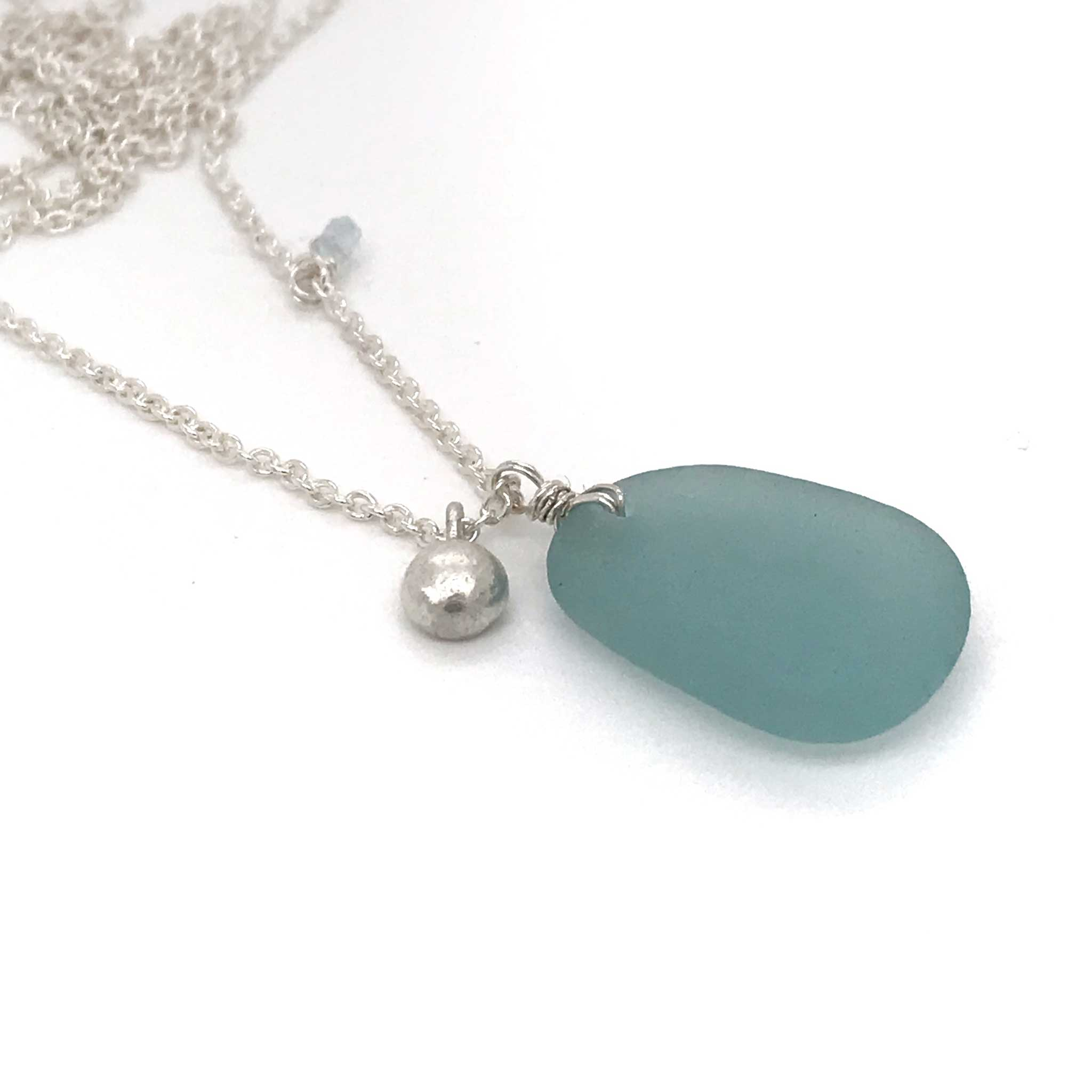 long necklace with aqua sea glass and silver pebble charm kriket broadhurst jewellery Australia