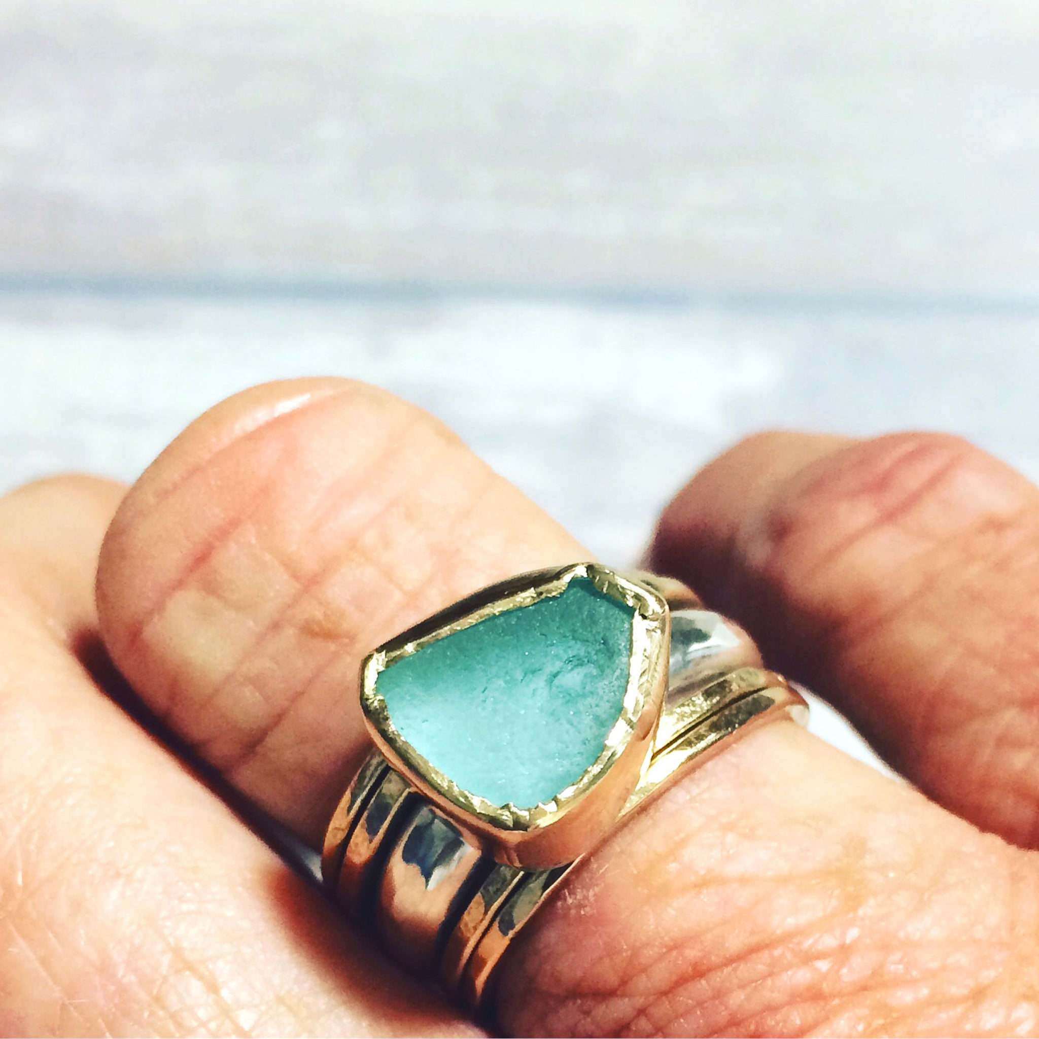 gold bezel aqua ring