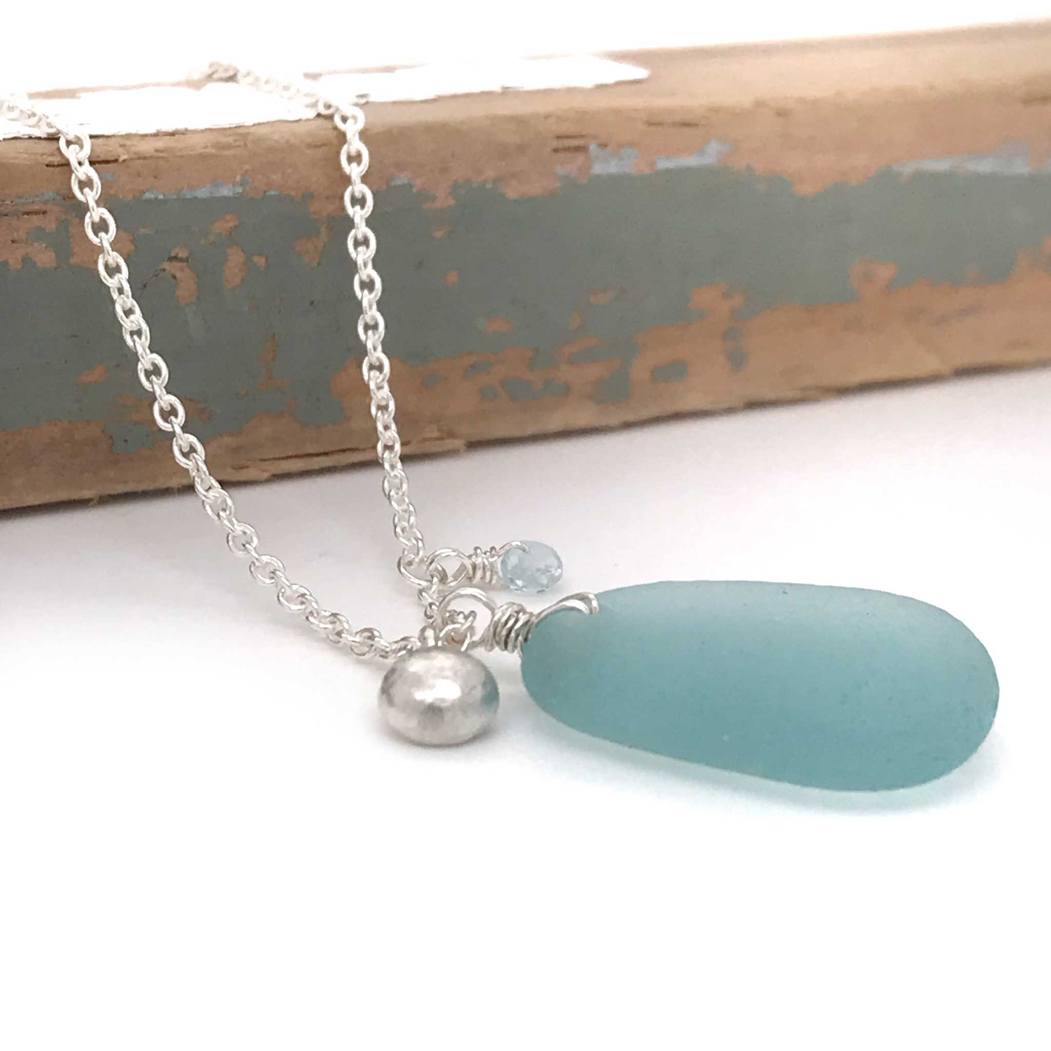 aqua blue sea glass on silver necklace with solid silver charm kriket broadhurst gifts for women Sydney