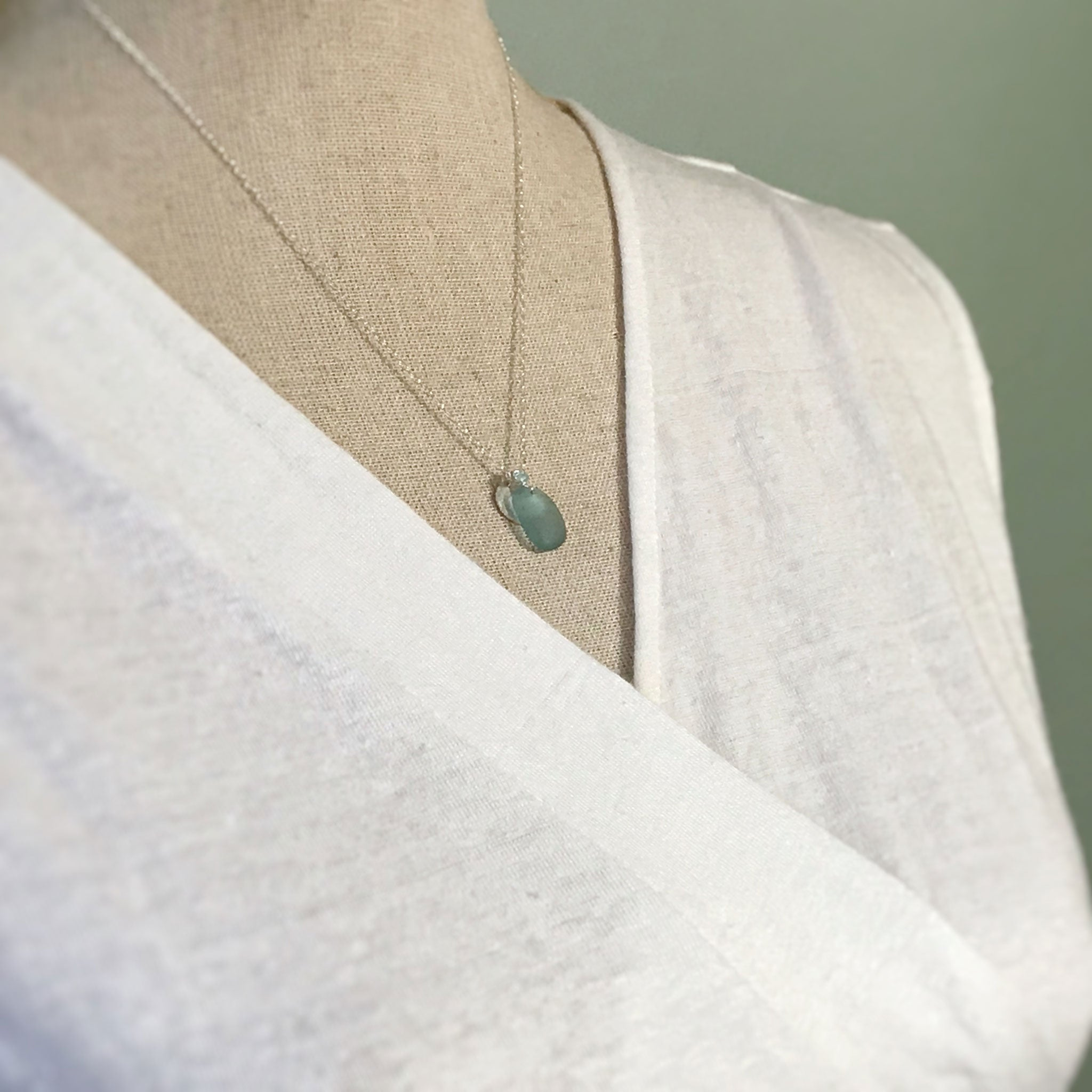 short silver necklace with aqua beach glass and disc charm kriket Broadhurst jewellery