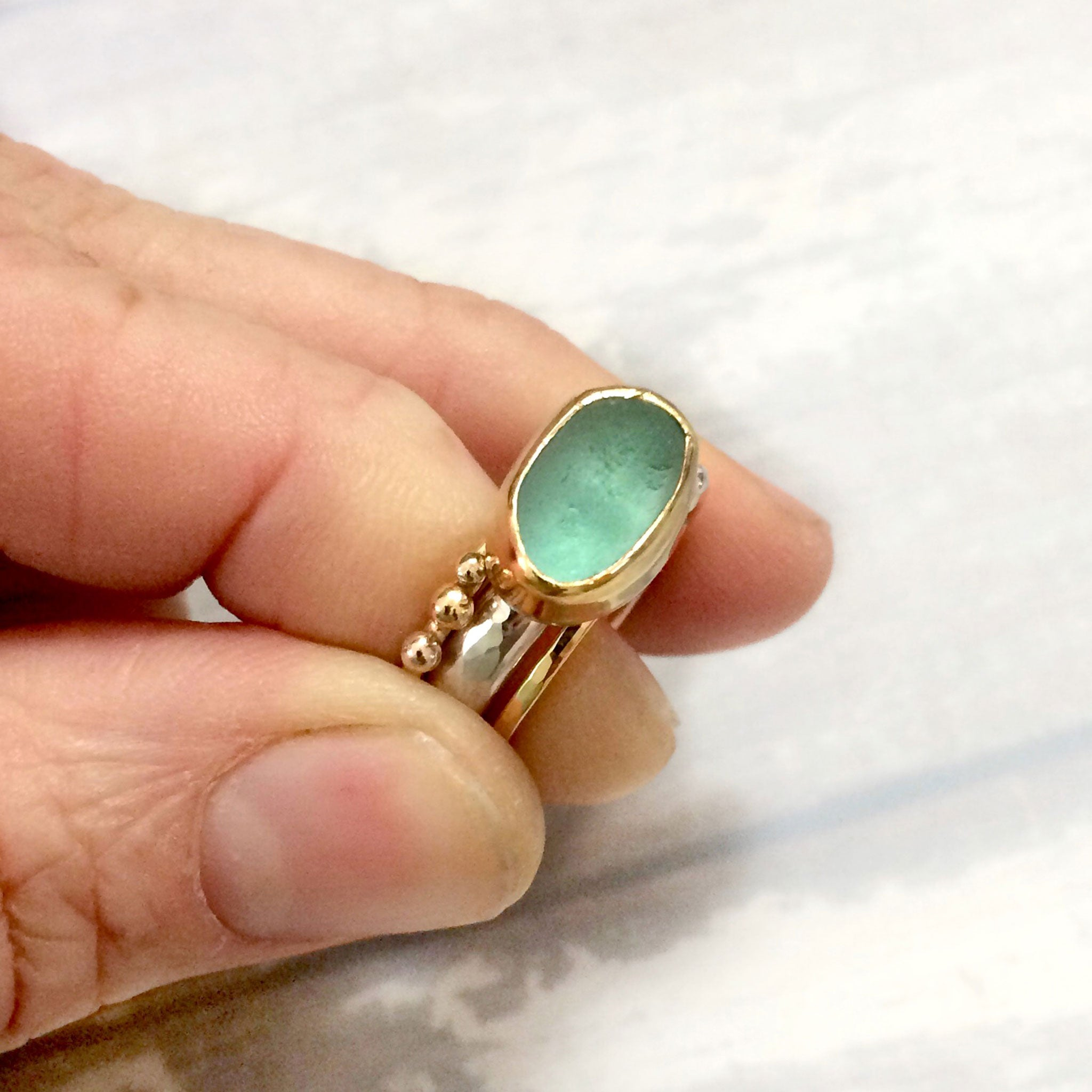 gold bezel on sterling silver ring with aqua seaglass kriket Broadhurst jewellery