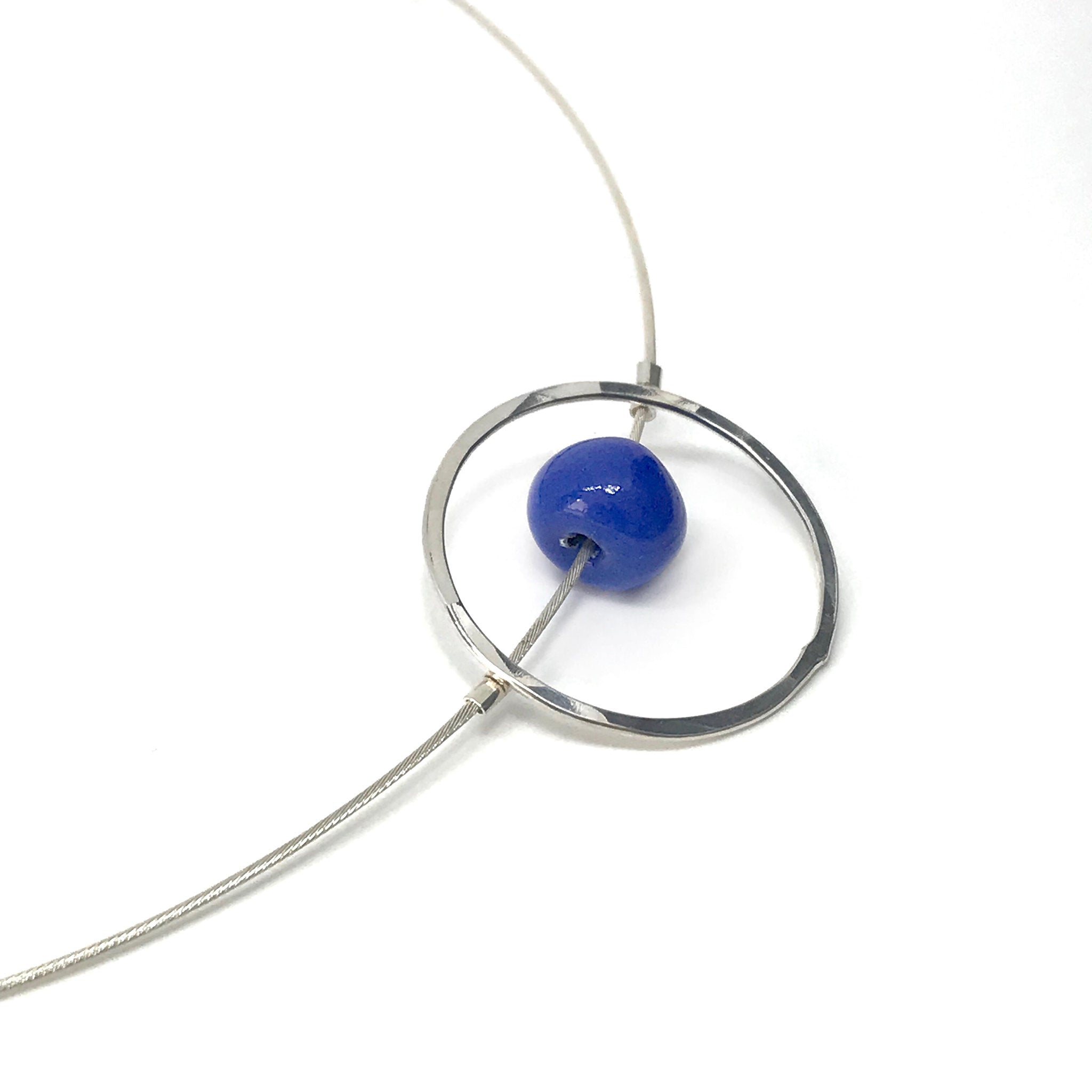 Silver Circle Necklace with Cornflower Blue Ceramic Bead - kriket-broadhurst