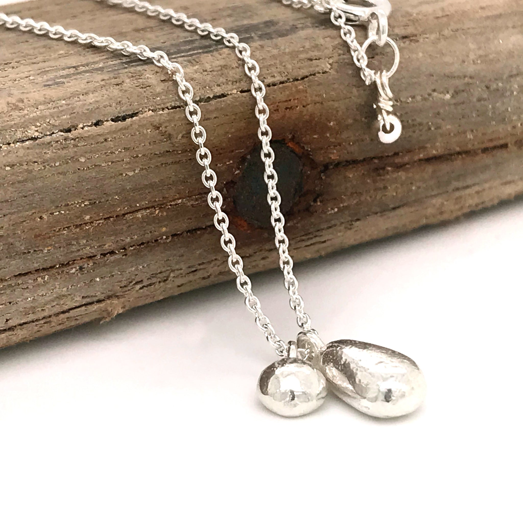 sterling silver charm necklace with duo of sterling silver charms kriket broadhurst jewellery