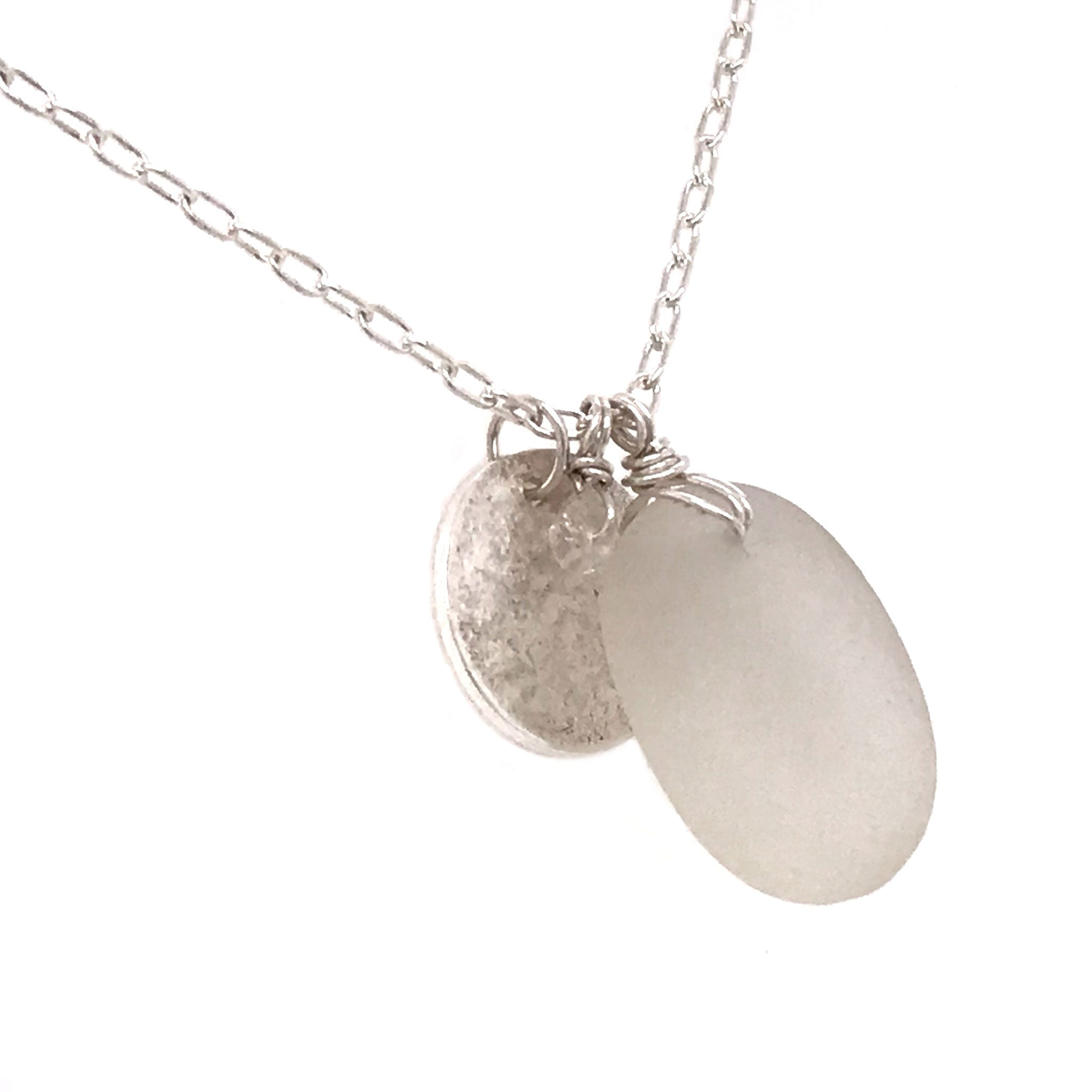 clear seaglass on silver necklace with hammered disc charm kriket broadhurst jewellery