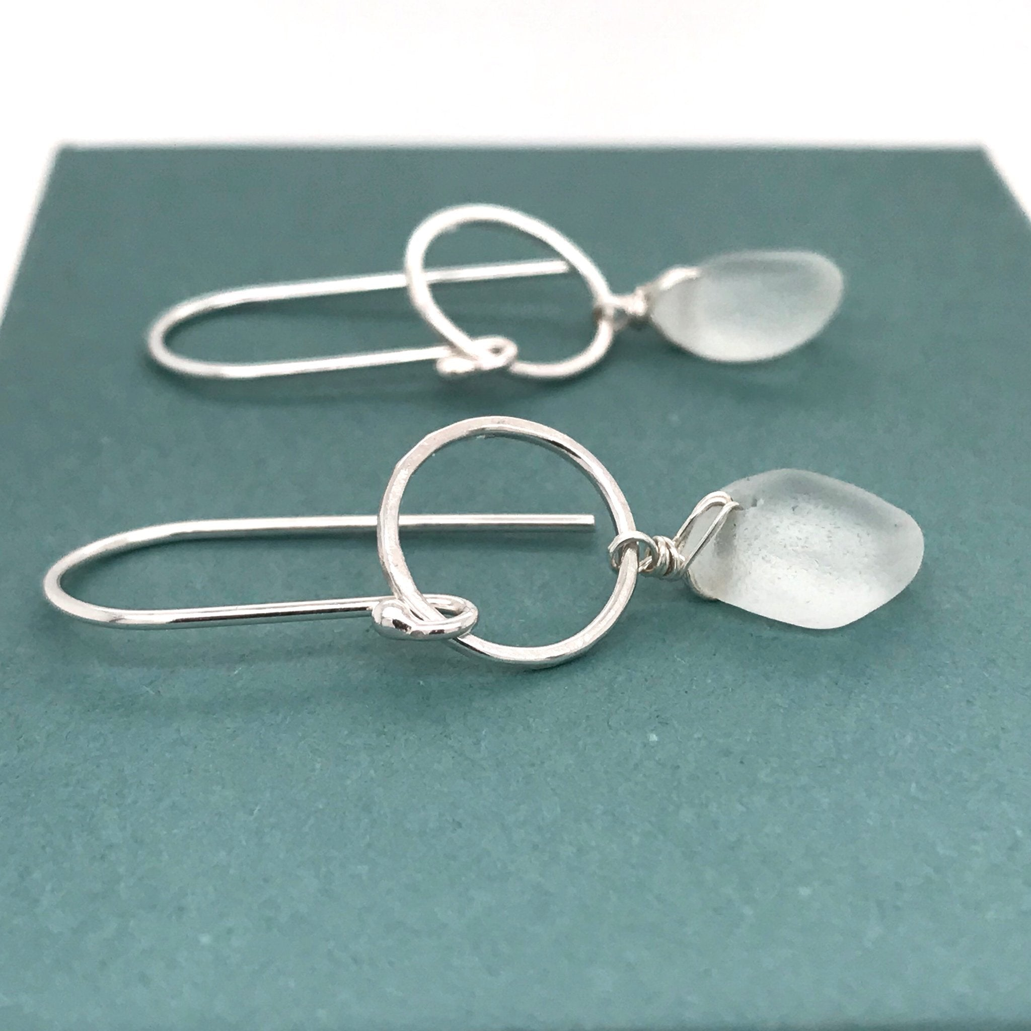 sterling silver earrings with clear seaglass circle design kriket broadhurst jewellery