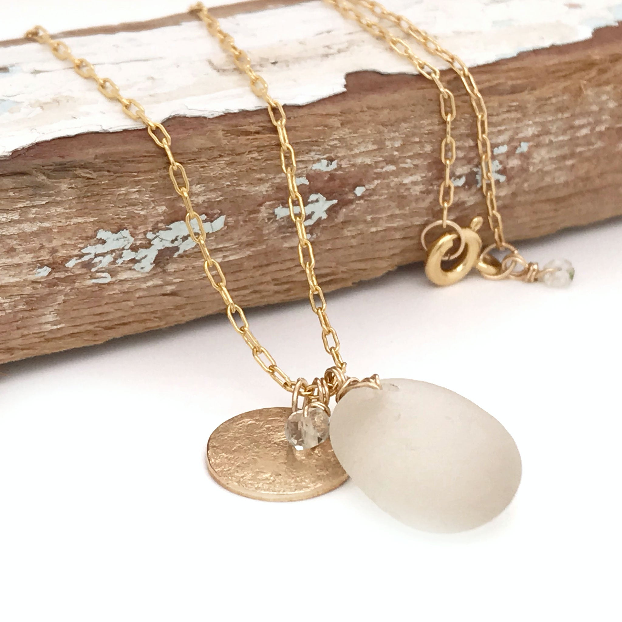 clear seaglass necklace gold chain with gold disc charm Kriket Broadhurst jewellery