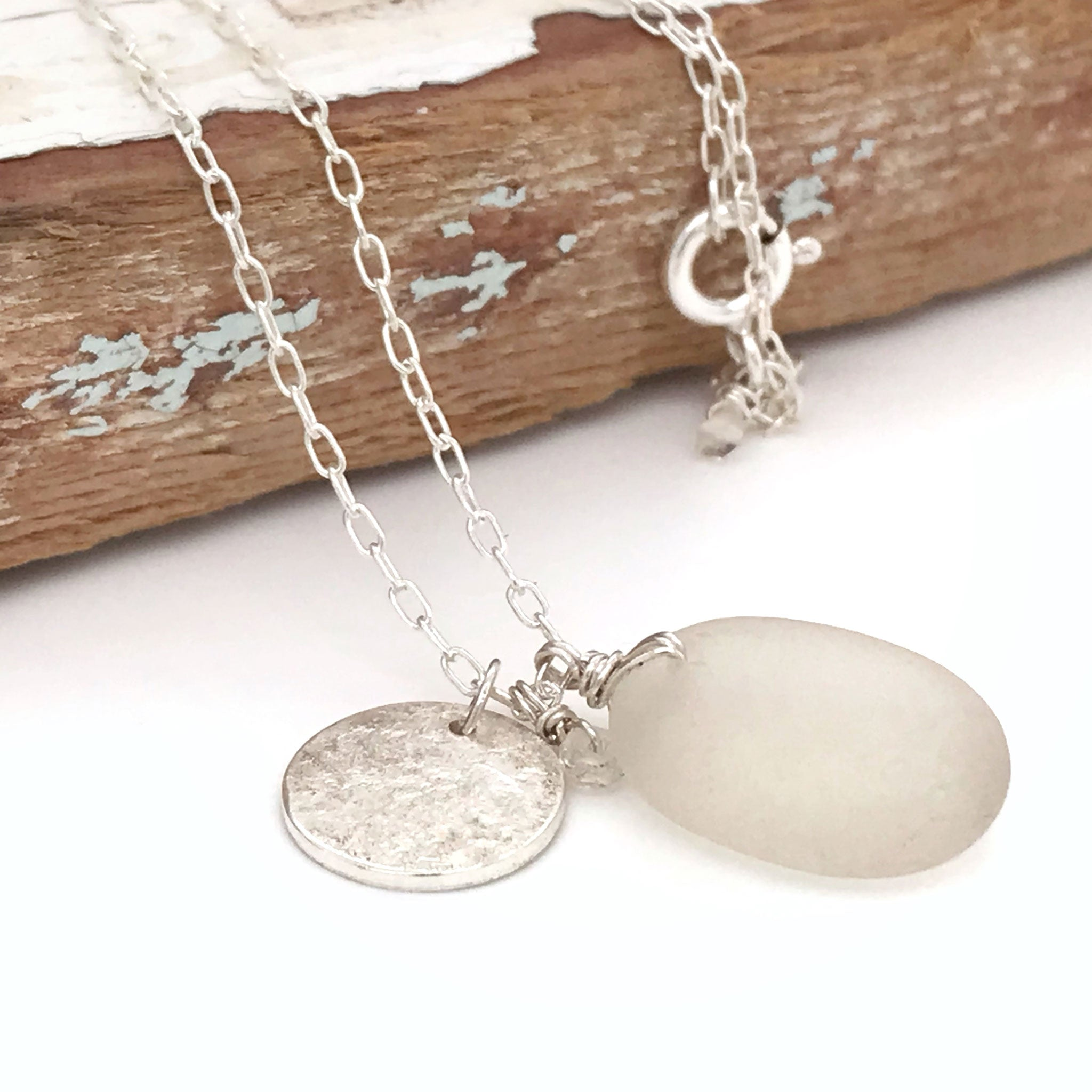 clear seaglass silver necklace with disc charm and aquamarines kriket broadhurst jewellery