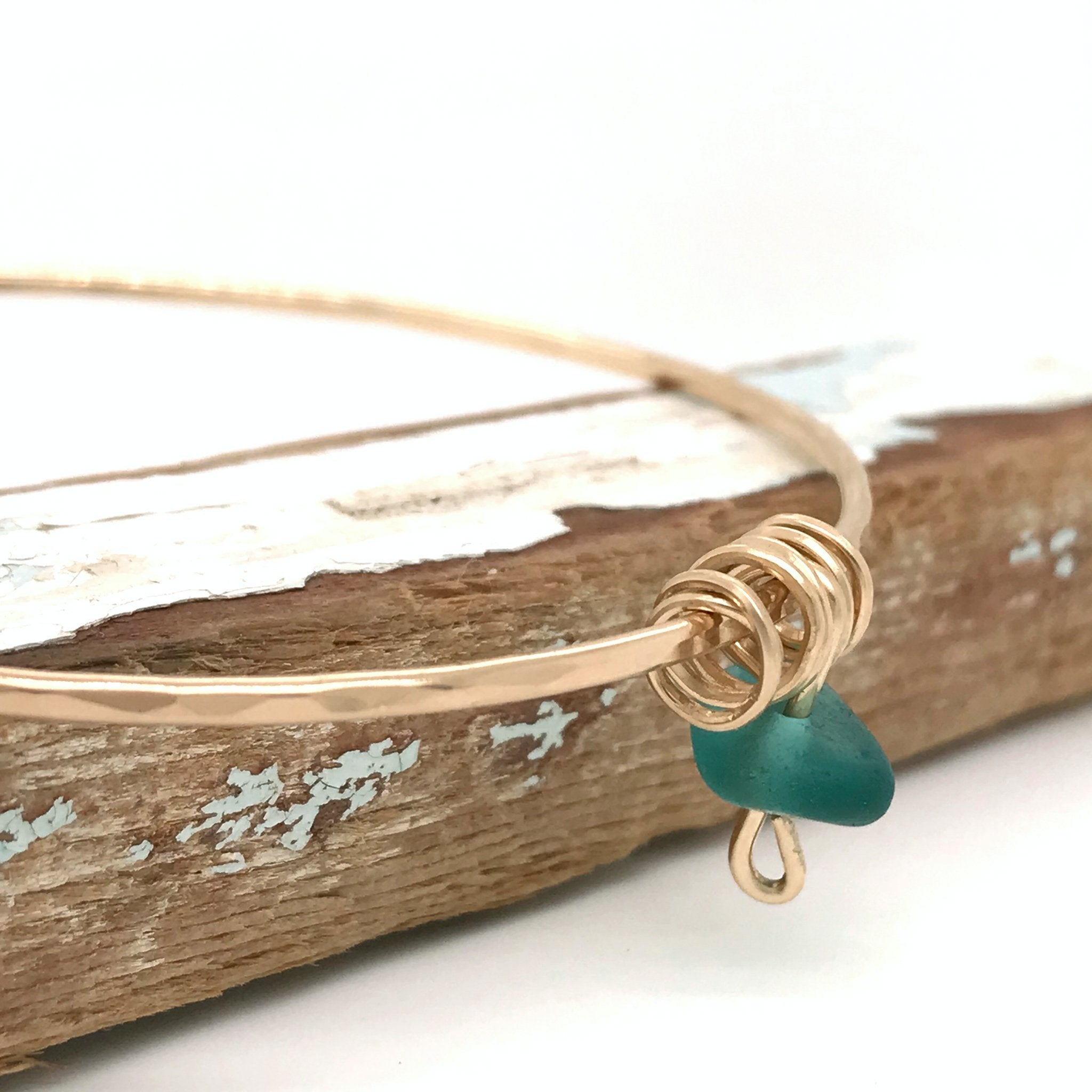teal green beach glass on gold bangle Kriket Broadhurst handmade jewellery