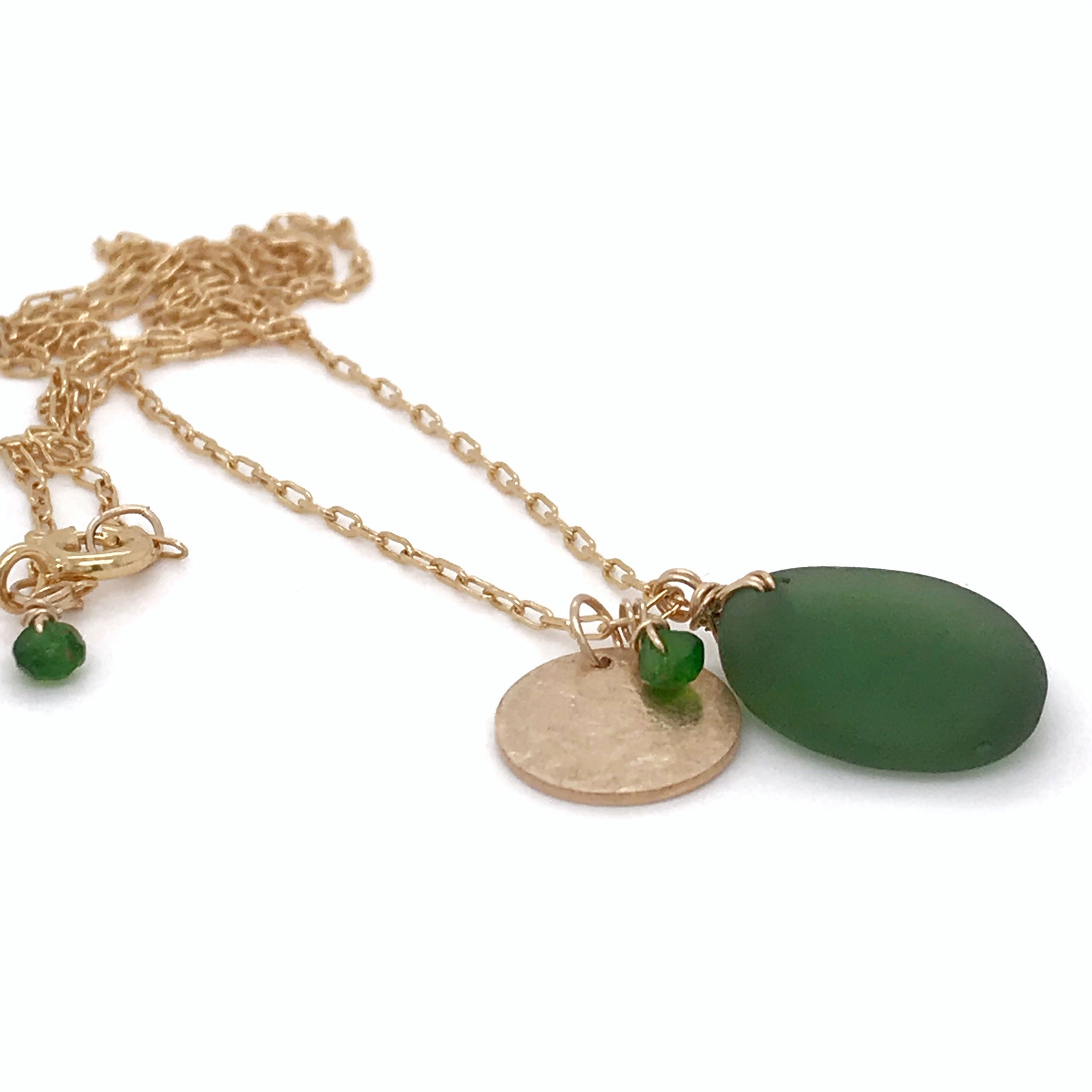 green seaglass gold necklace with gold disc charm and tsavorite stones kriket broadhurst jewellery