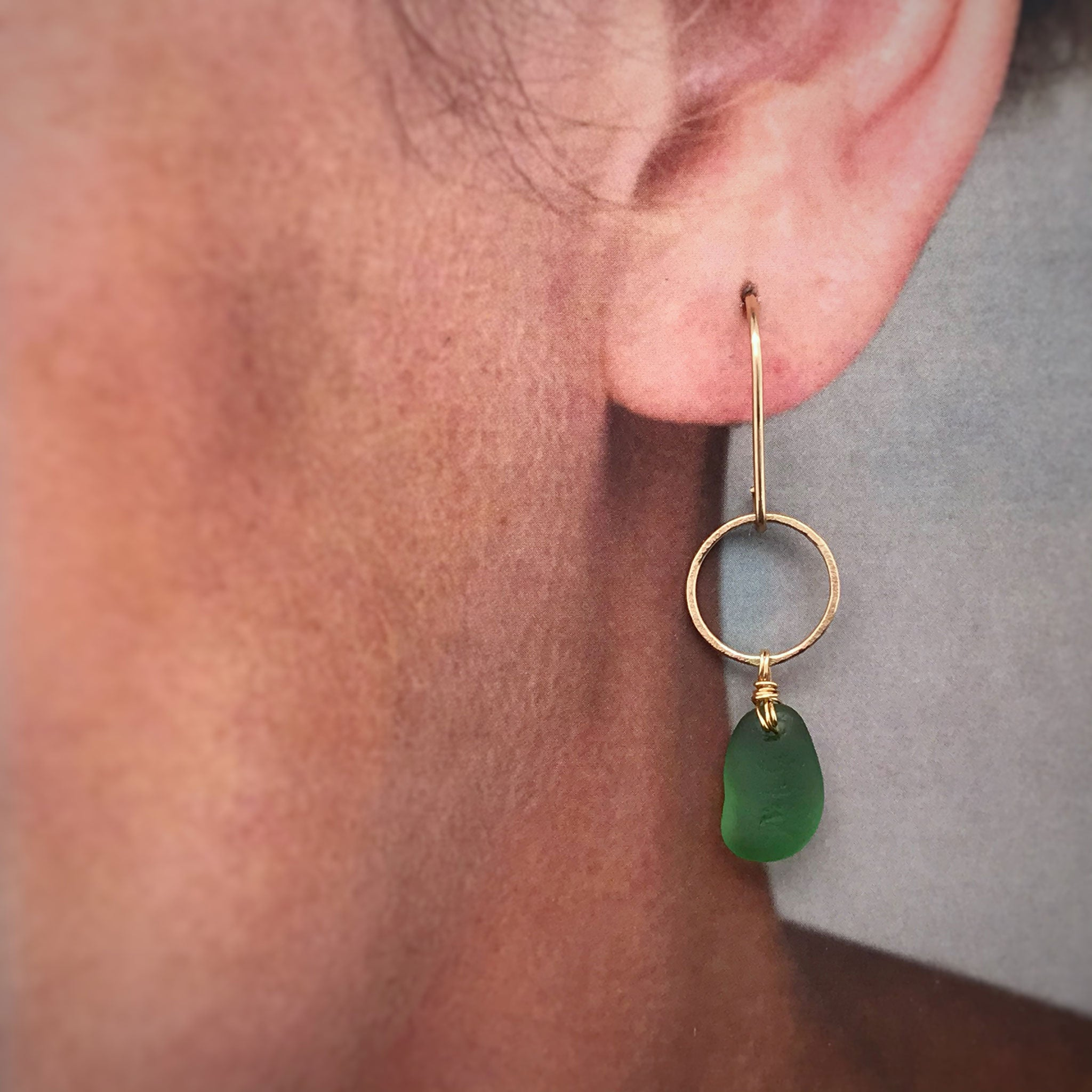 gold circle earrings with green seaglass Kriket broadhurst jewellery