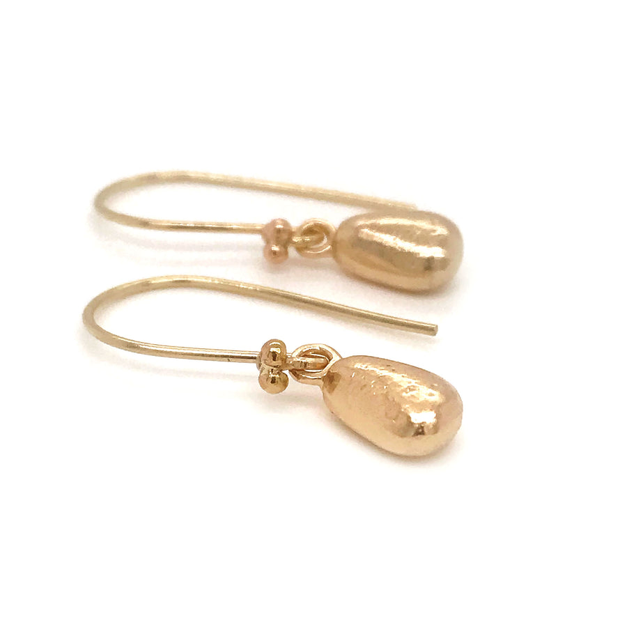 gold earrings with solid gold seaglass charms kriket broadhurst jewelry