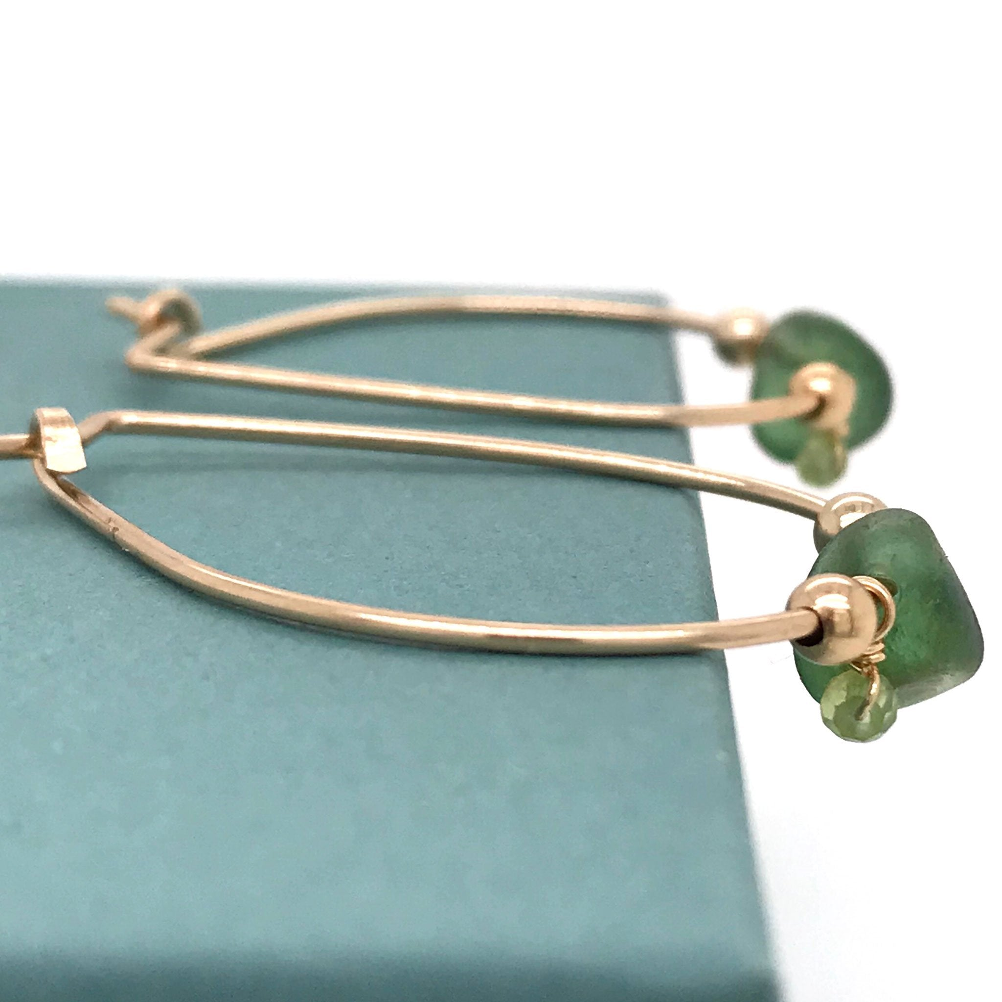dark green seaglass gold hoop earrings with peridot stones Kriket Broadhurst jewellery