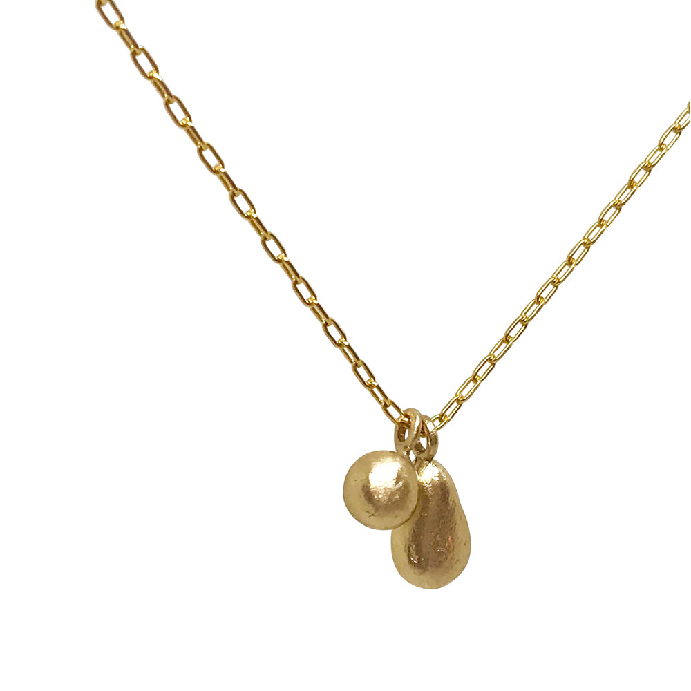Gold Necklace with Teardrop and Pebble Charms  - kriket broadhurst jewellery