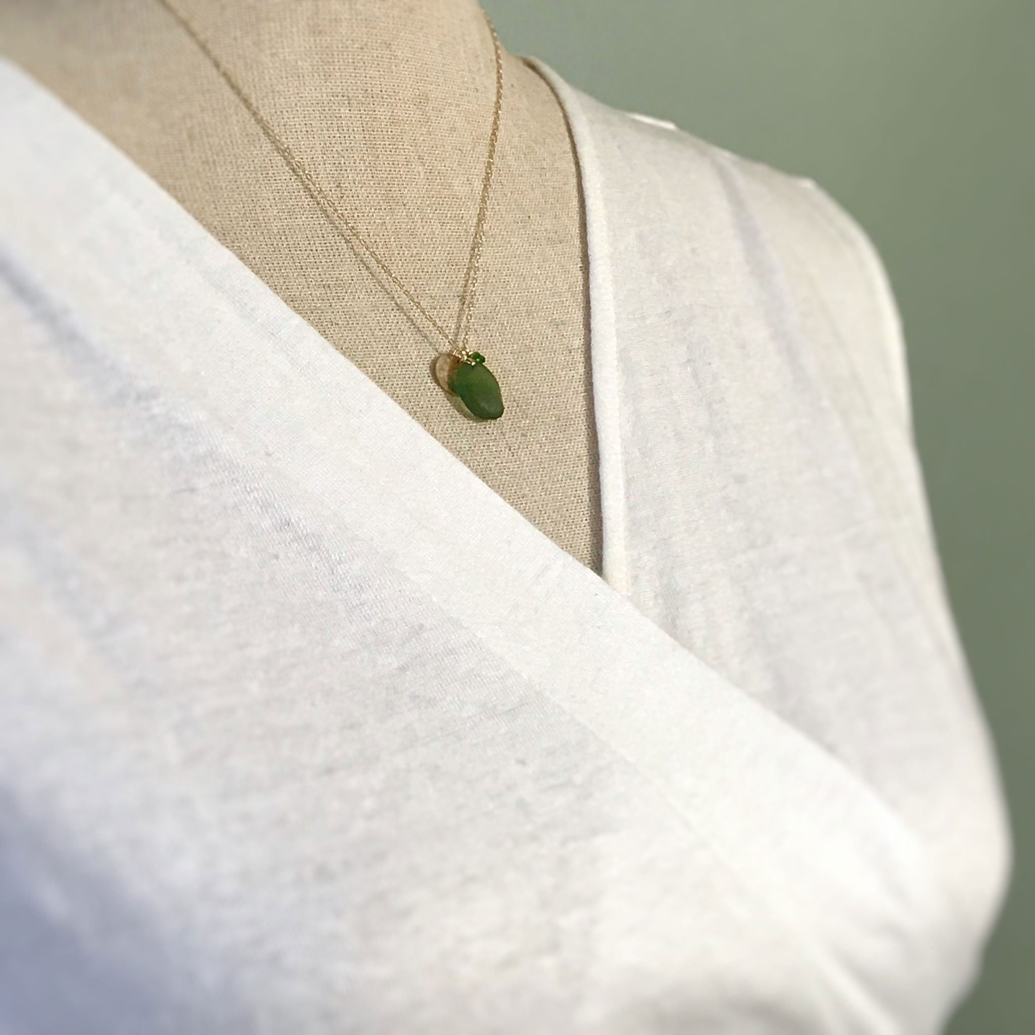 green and gold necklace seaglass with gold disc and tsavorite stones kriket broadhurst jewellery