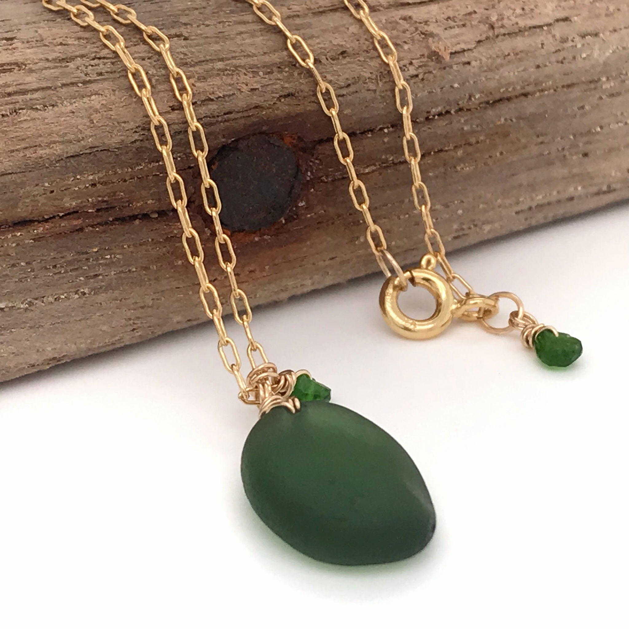 green seaglass necklace with tsavorite stones on gold chain kriket Broadhurst jewellery