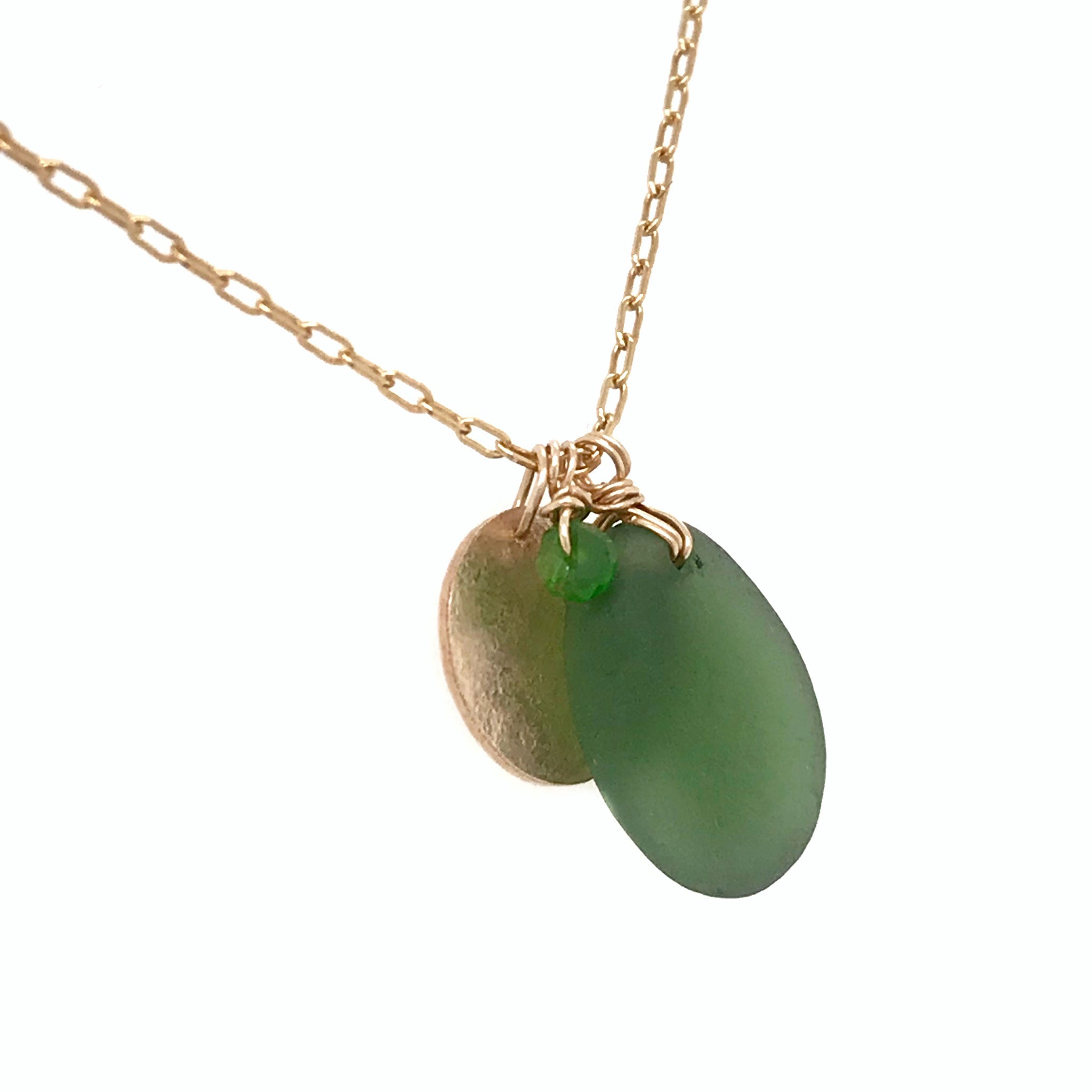 gold charm necklace with green seaglass pendant and gold disc kriket Broadhurst jewellery