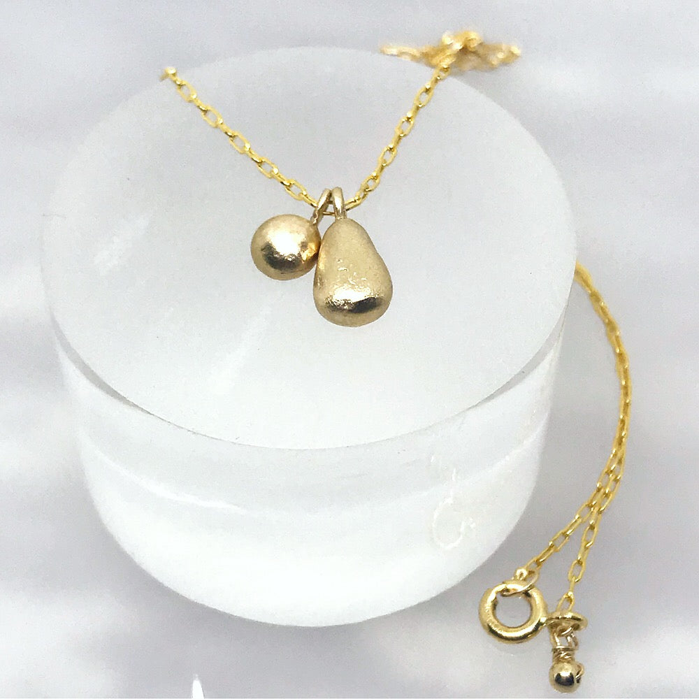 Gold Necklace with Teardrop and Pebble Charms  - kriket broadhurst minimalist jewellery