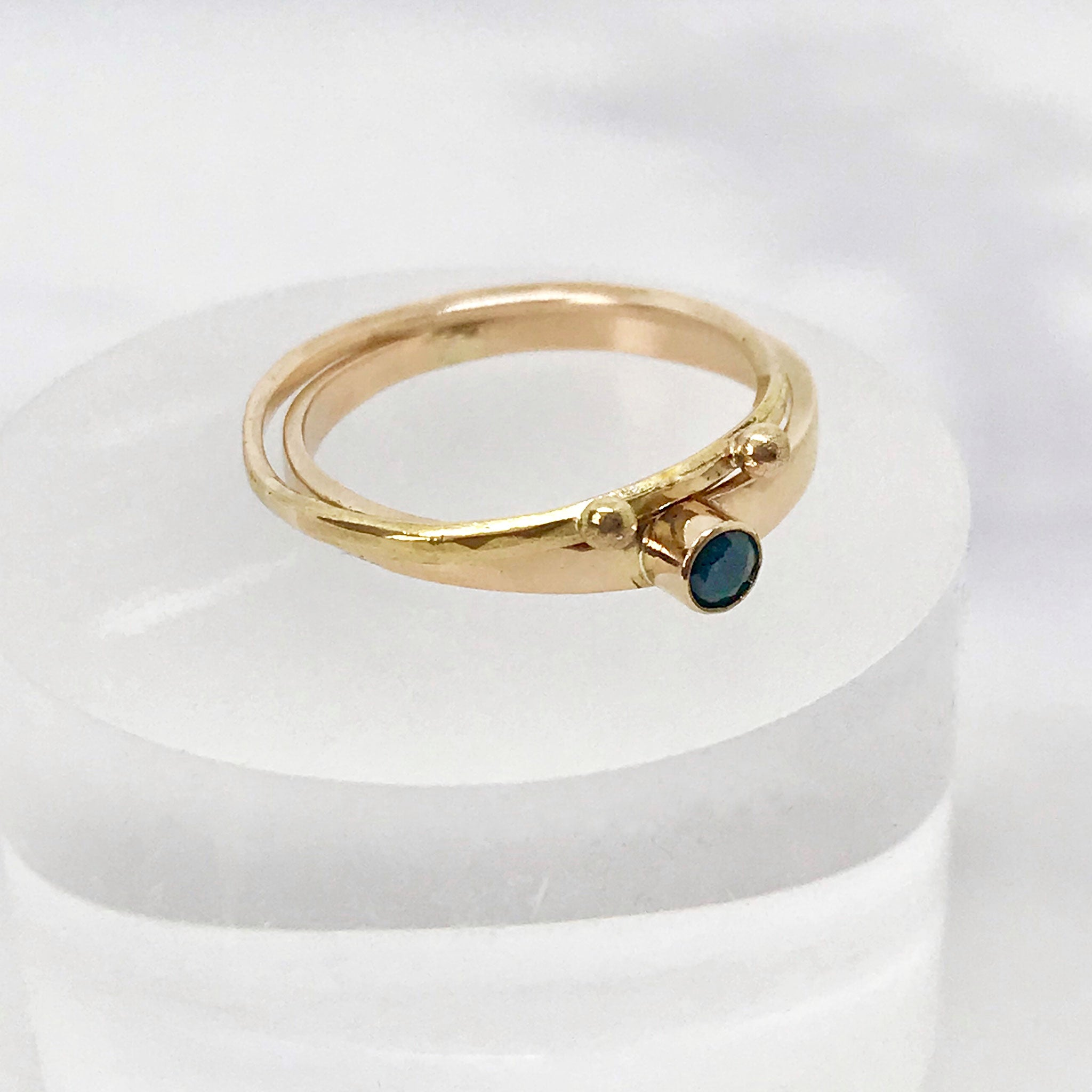 Gold ring with blue green parti sapphire bezel set in 14k gold kriket broadhurst jewellery