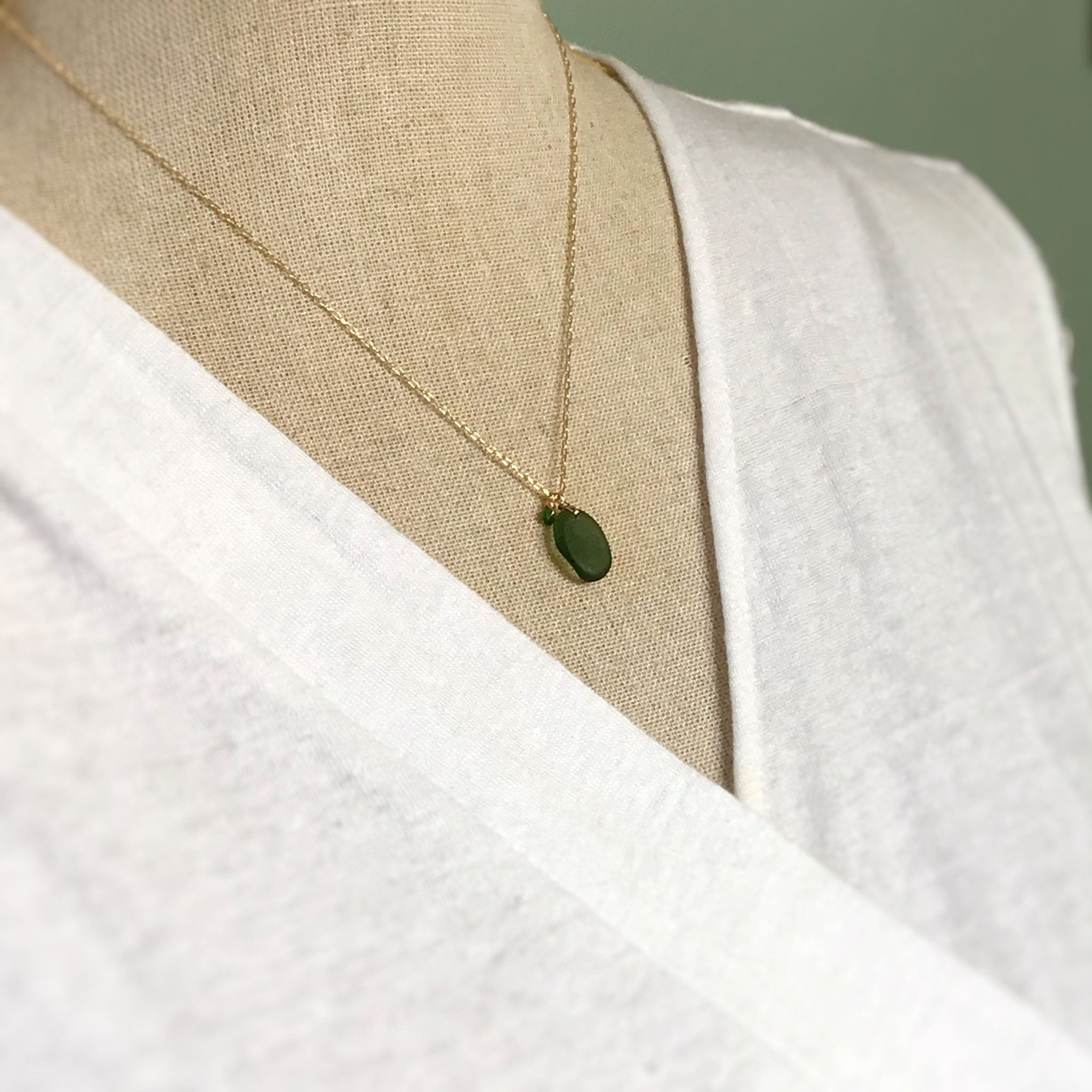 green beach glass necklace with tsavorite stones on gold chain kriket Broadhurst jewellery