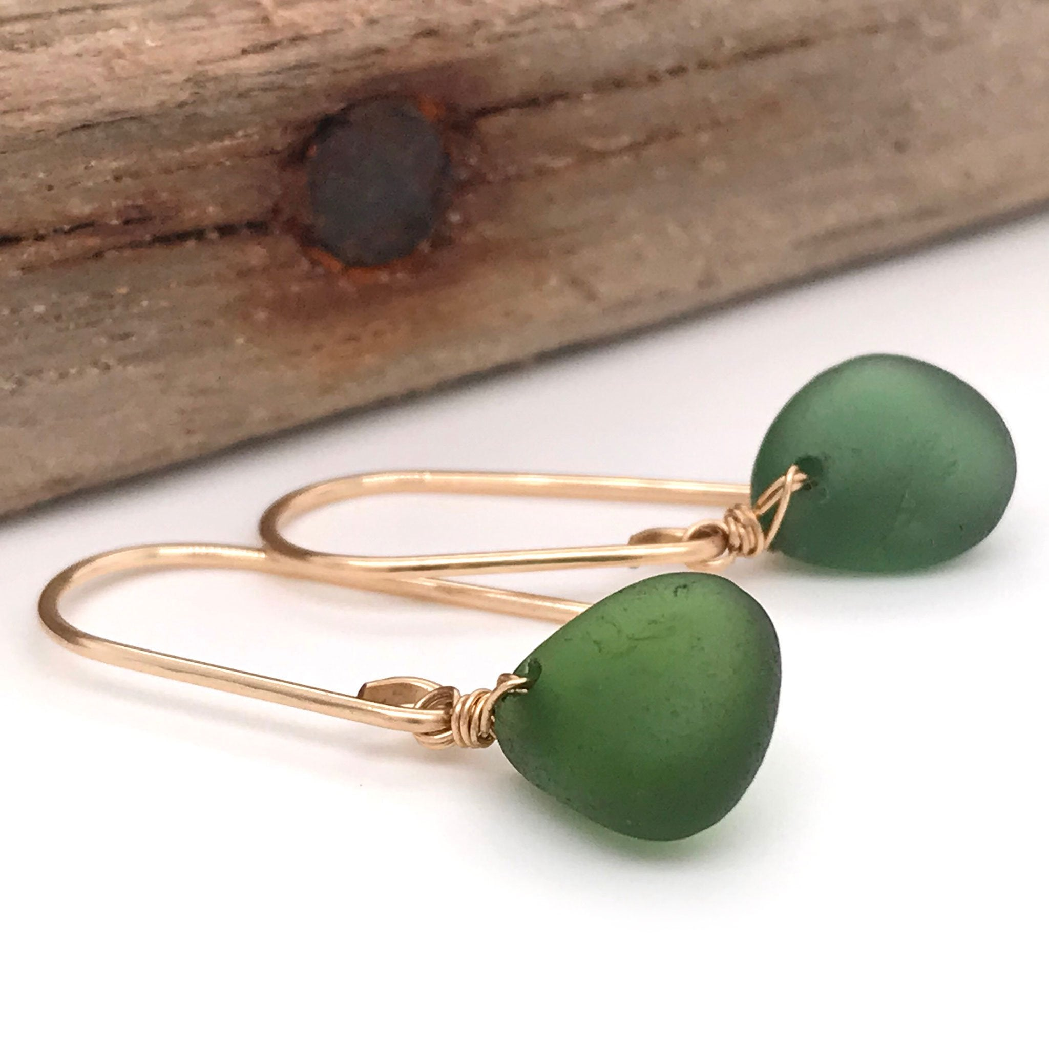 short gold earrings with green seaglass Kriket Broadhurst jewelry