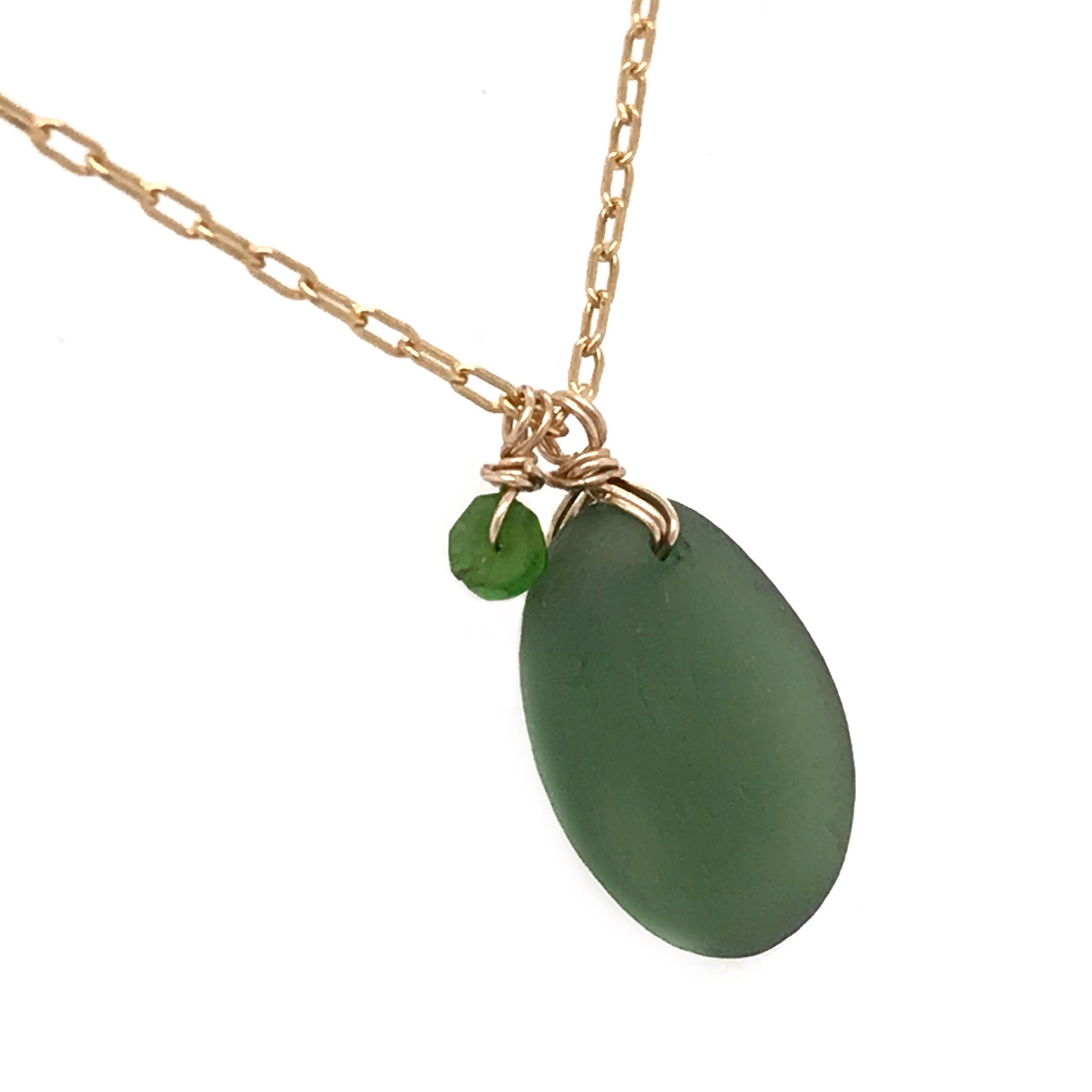 green seaglass on gold necklace with tsavorite stones kriket Broadhurst jewellery