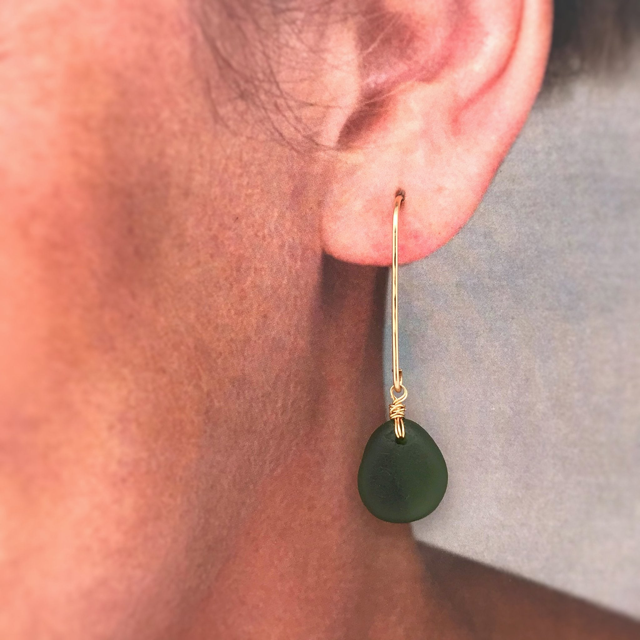 dangly gold earrings with green sea glass kriket broadhurst jewellery
