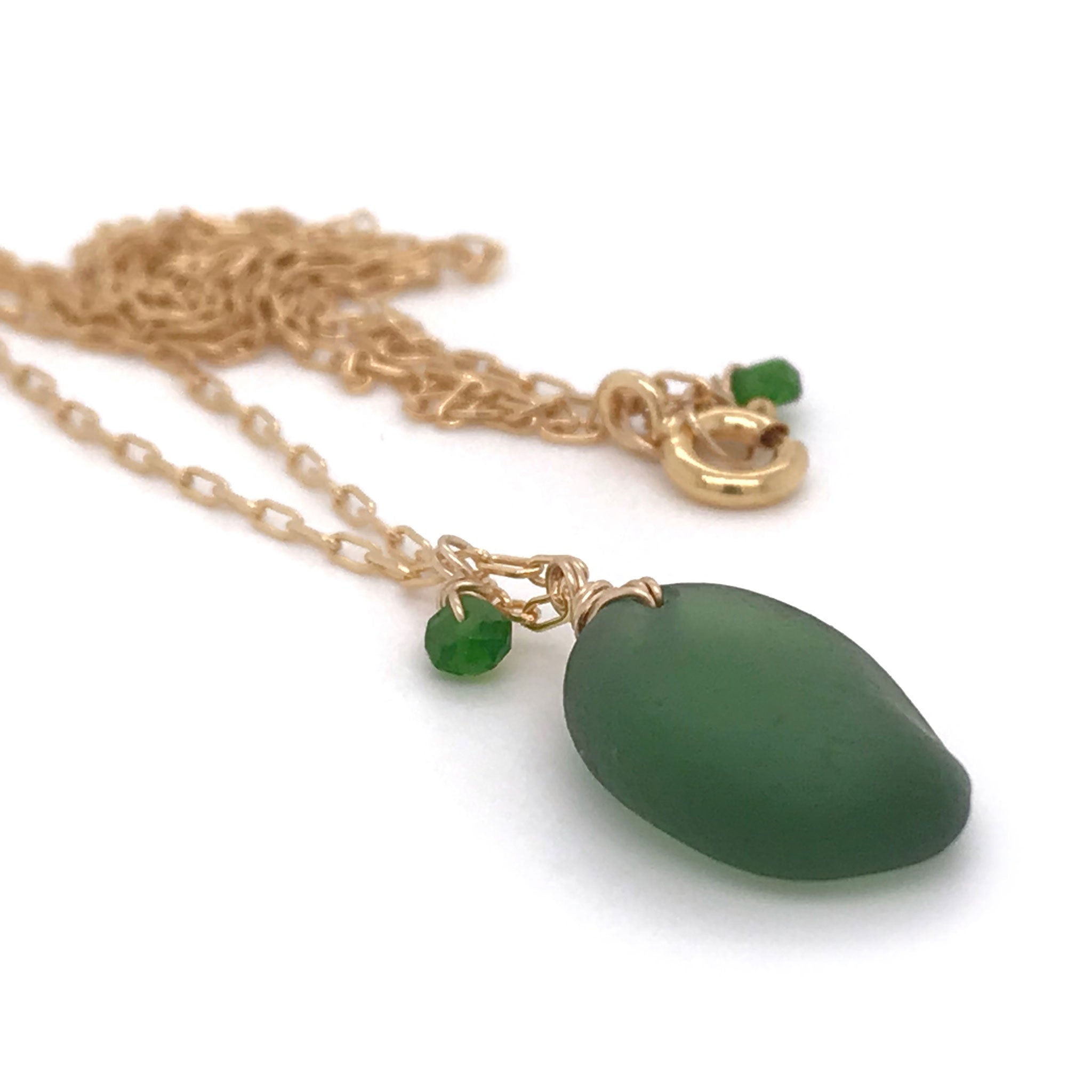 green seaglass necklace with tsavorite stones on gold chain kriket Broadhurst jewelry