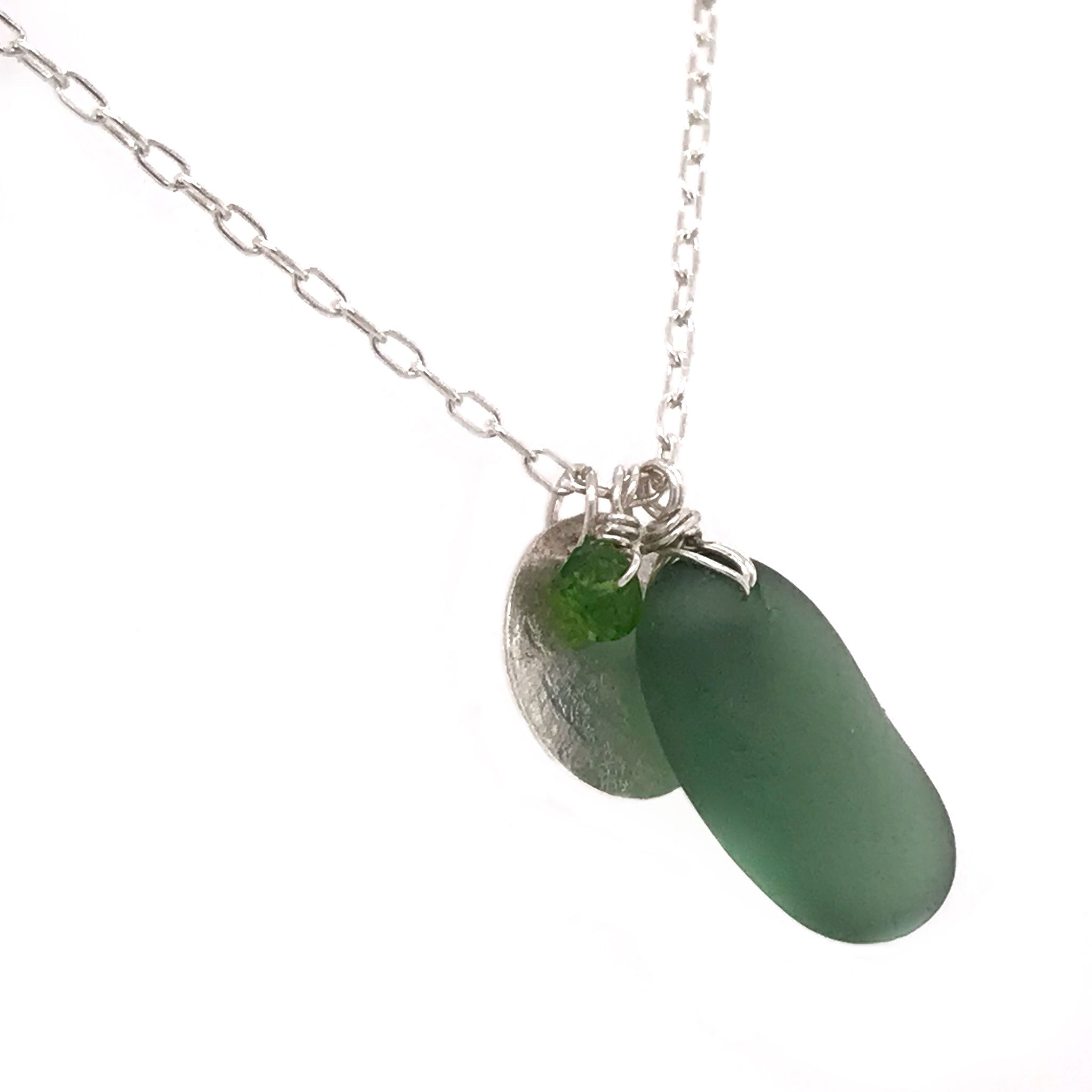 green seaglass charm necklace with silver disc and tsavorite stones kriket broadhurst jewellery