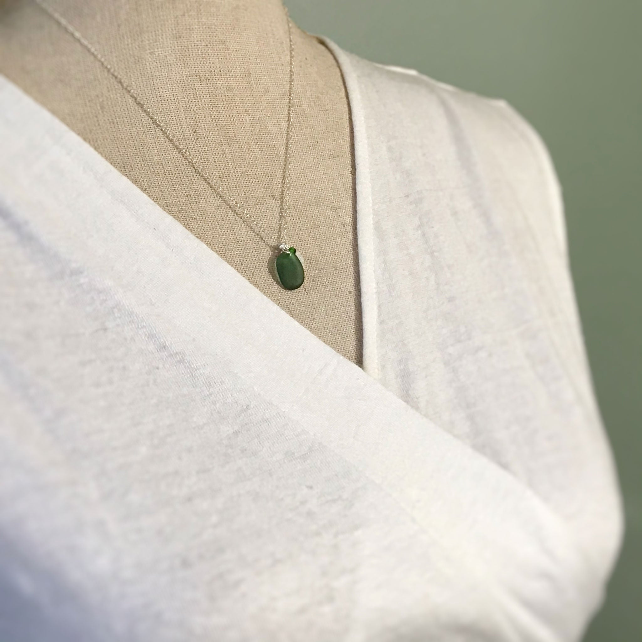 green beach glass on sterling silver chain with silver hammered disc kriket broadhurst jewellery