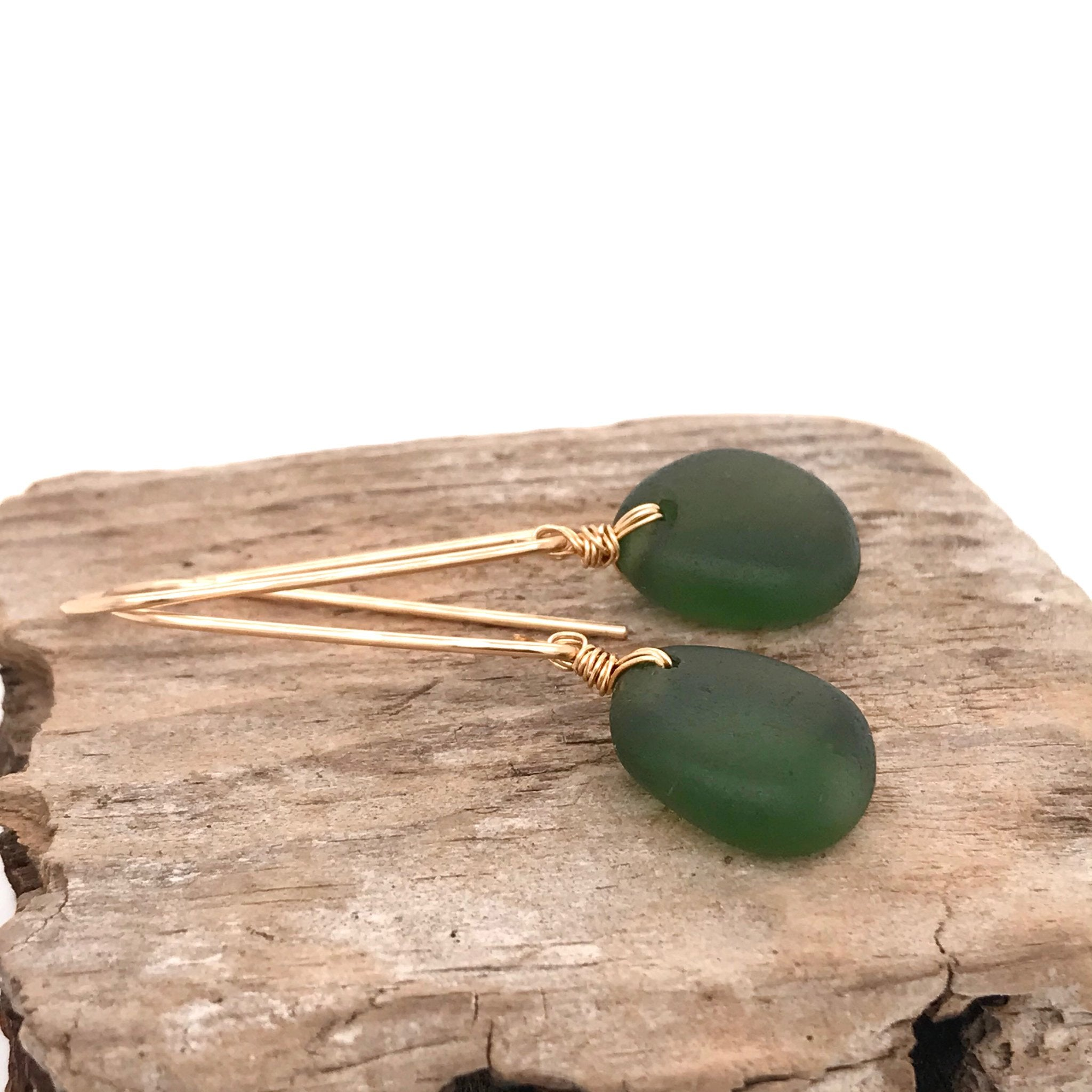 long gold earrings with green seaglass kriket broadhurst jewellery