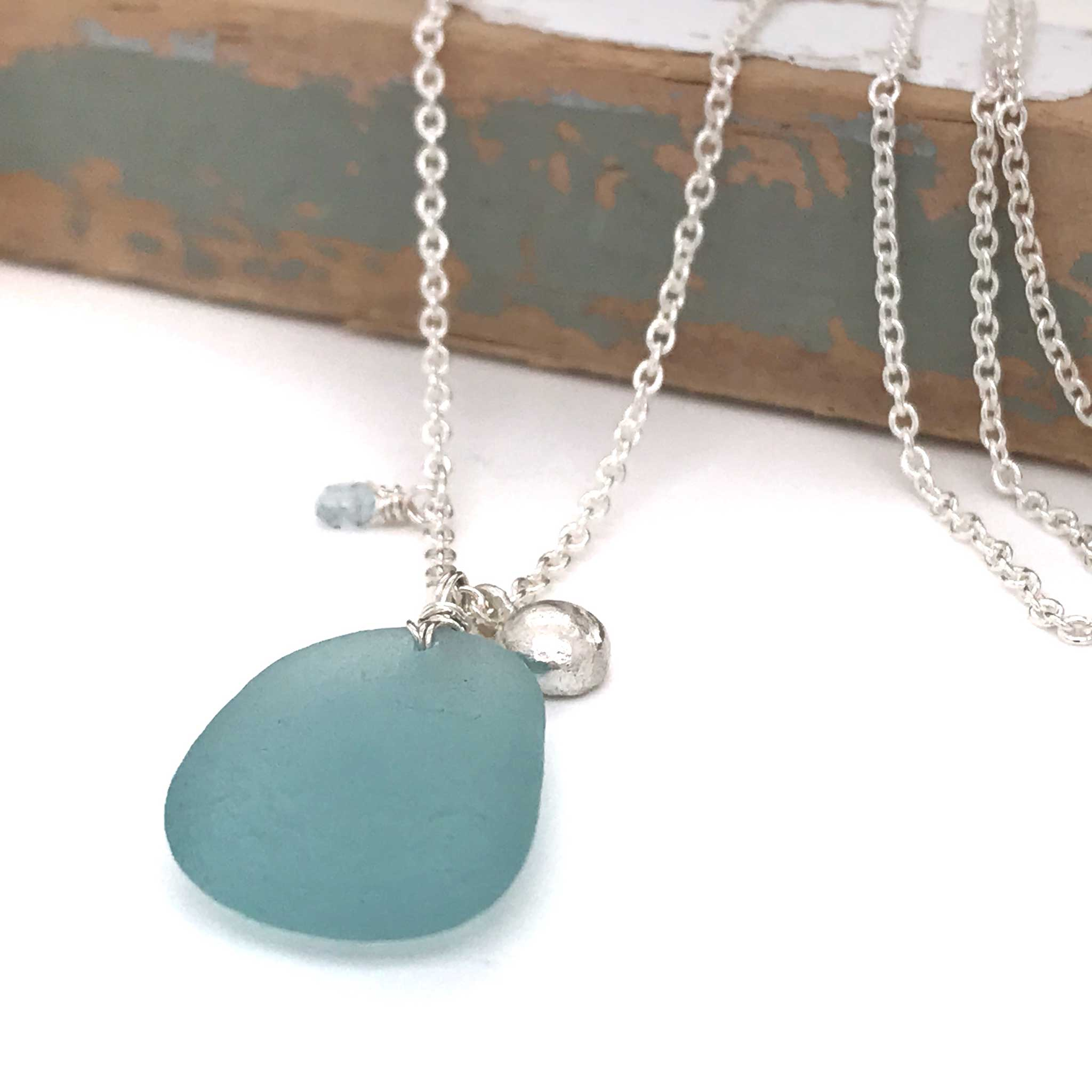 aqua beach glass necklace with solid silver pebble charm kriket broadhurst jewellery Sydney
