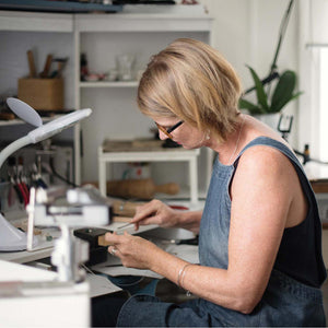 kriket broadhurst working in her studio