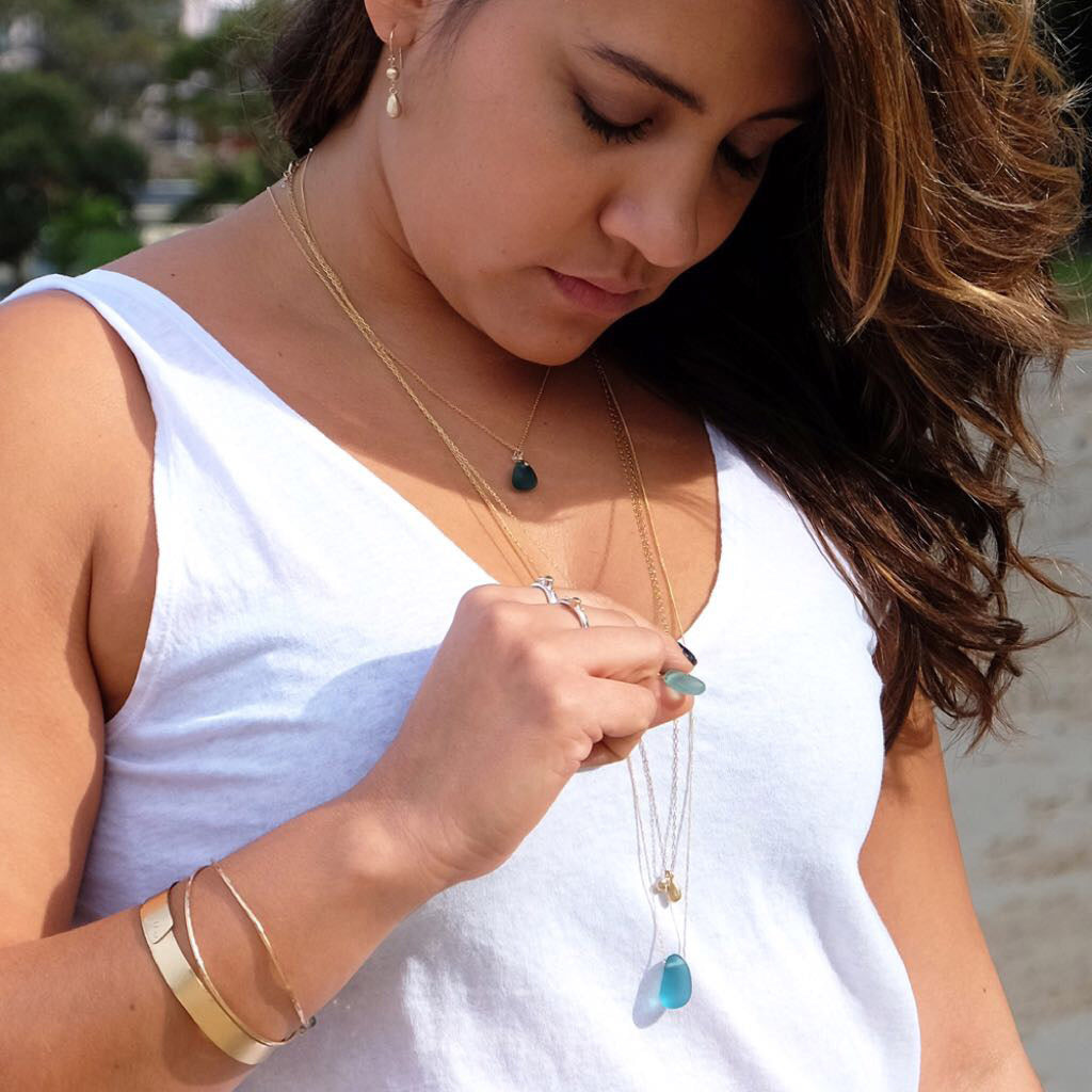 seaglass jewellery Sydney Kriket Broadhurst gold and silver necklaces on model