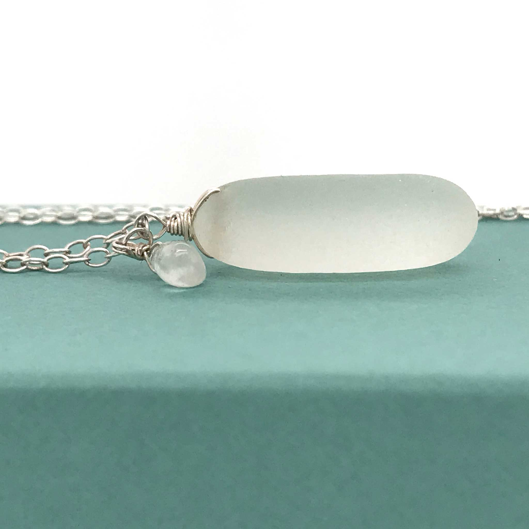 clear sea glass pendant on sterling silver chain with teardrop aquamarine kriket broadhurst jewellery Australia