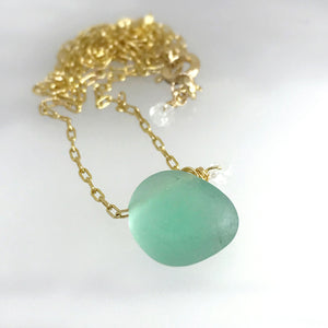 Kriket Broadhurst jewellery aqua seaglass on gold chain with aquamarine semi-precious stone