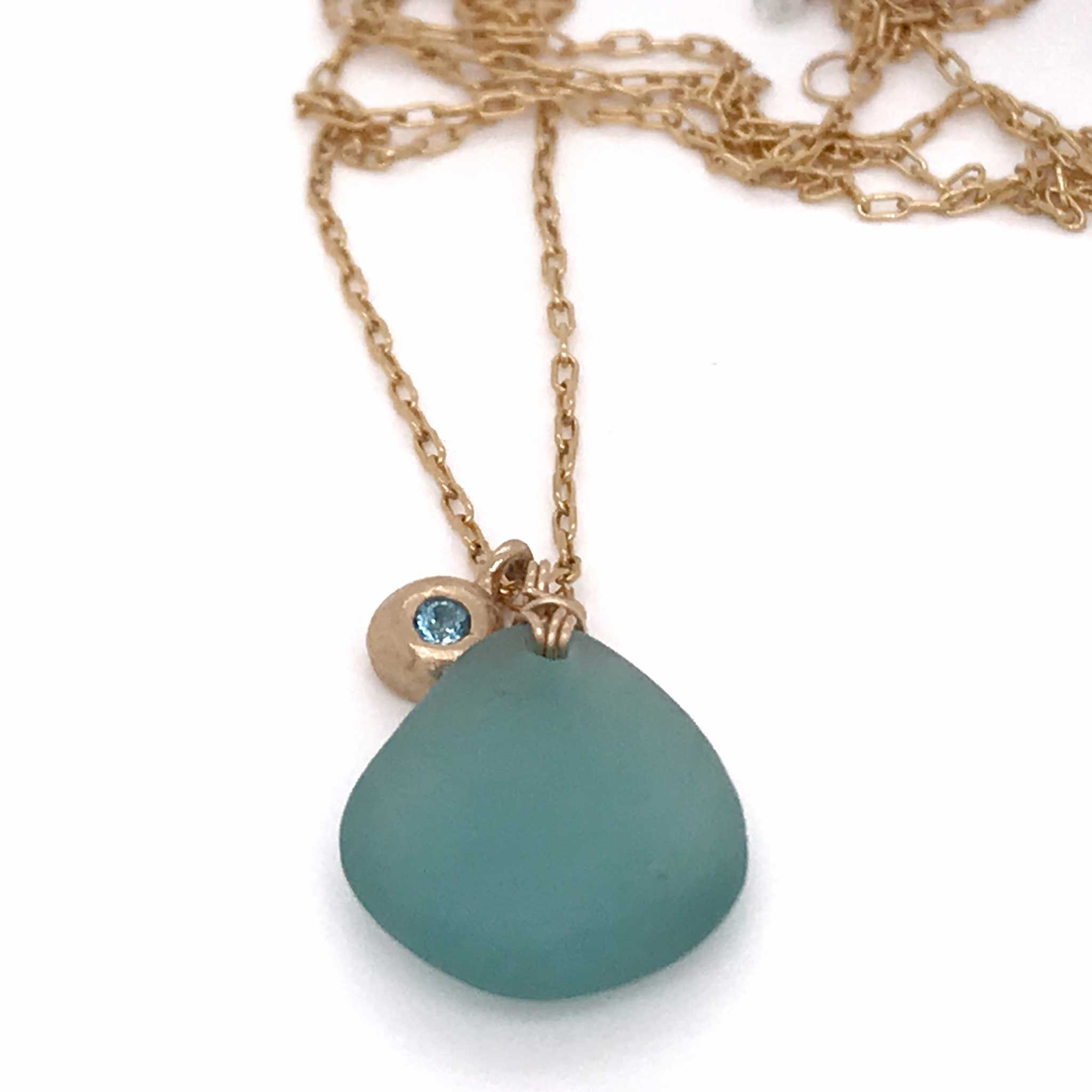 rare aqua sea glass necklace with gold charm and london blue topaz kriket broadhurst unique jewelry