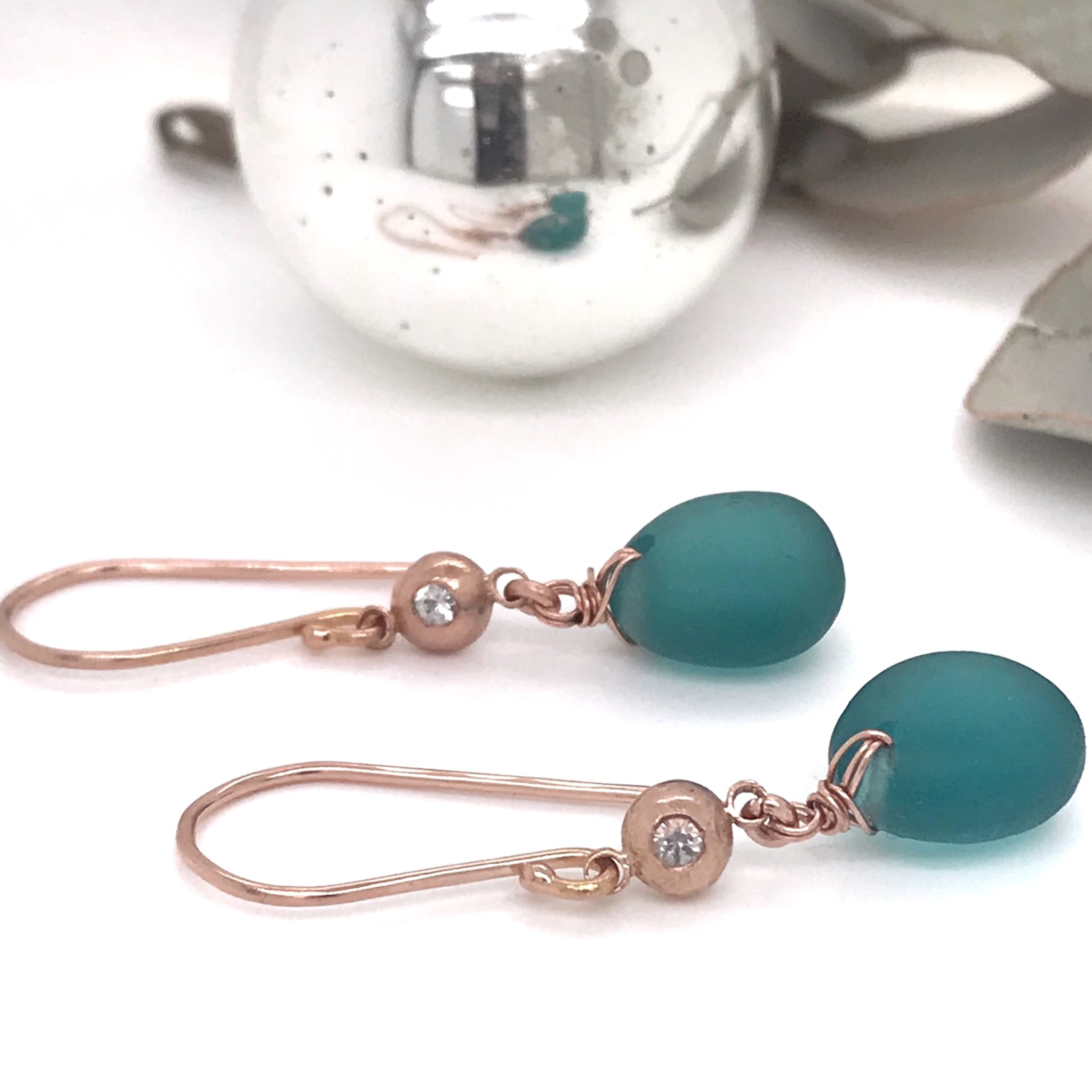 rose-gold-earrings-with-teal-sea-glass_-14k-rose-gold-pebble-charms-and-white-sapphires-kriket-broadhurst-jewelry-Sydney