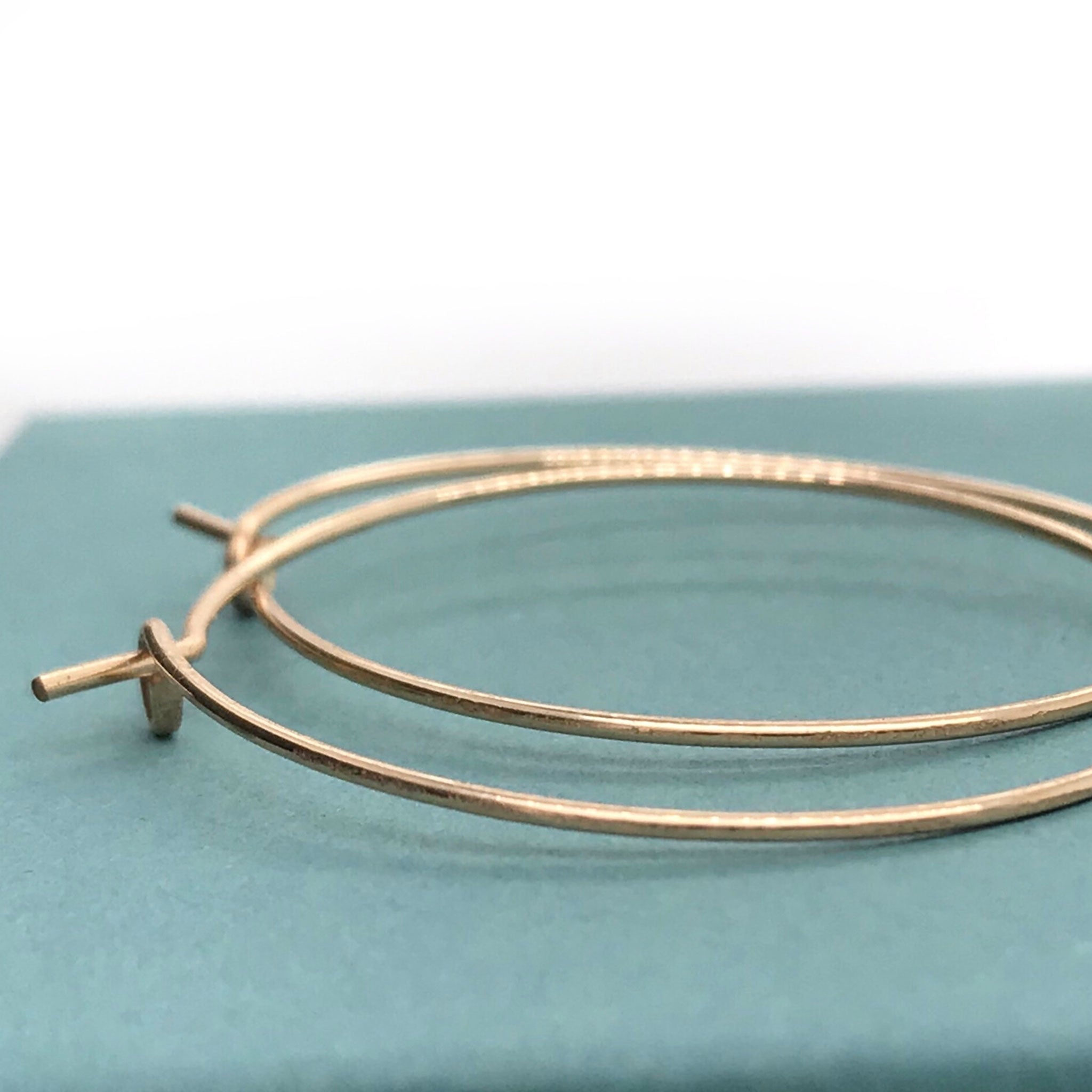 round hoop earrings in gold Kriket Broadhurst jewellery