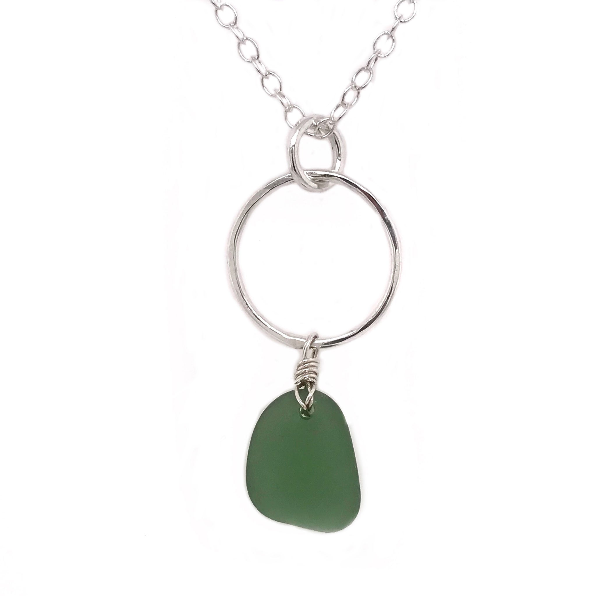 sterling silver necklace with circle design and green seaglass Kriket broadhurst jewellery