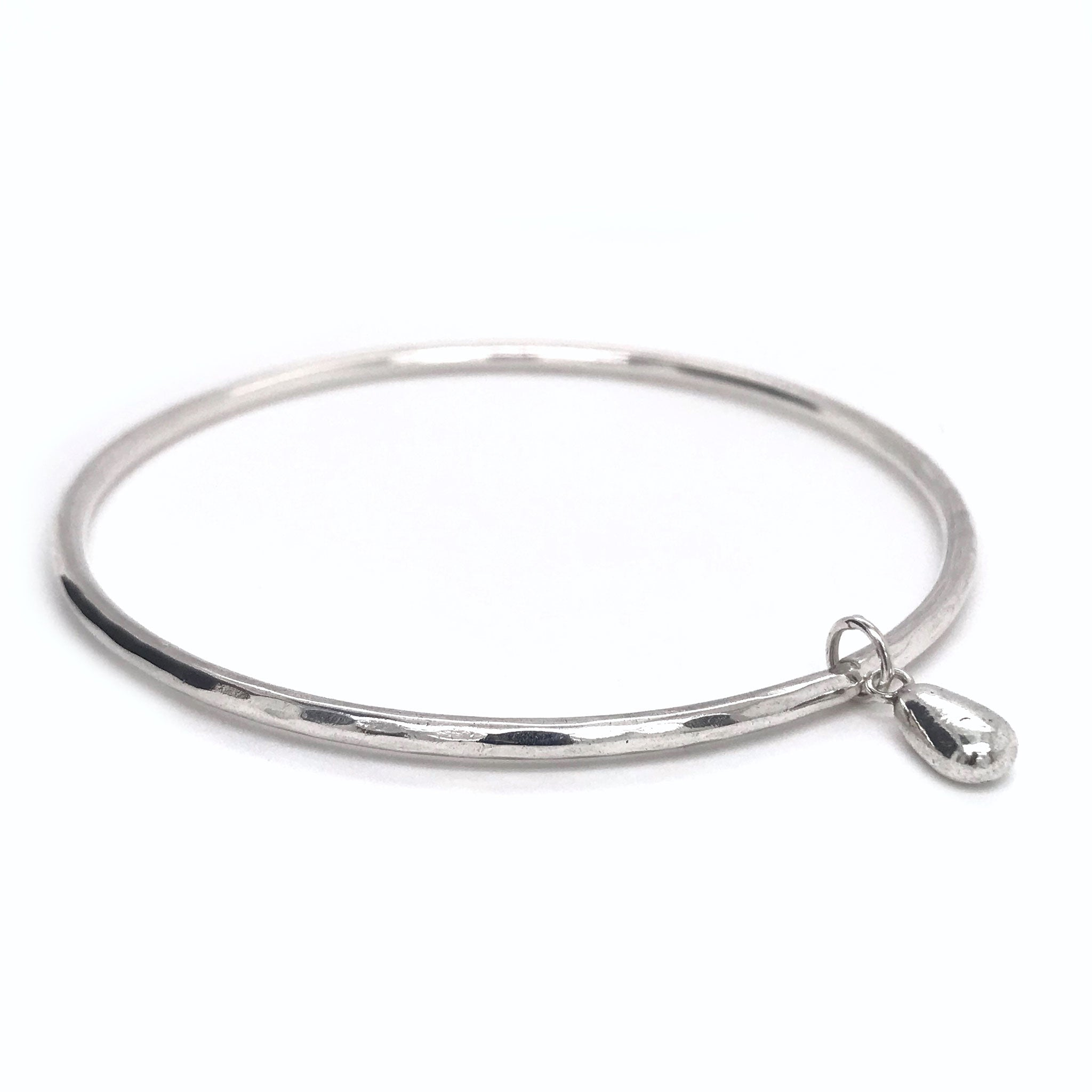 solid silver charm on silver bangle Kriket Broadhurst jewellery